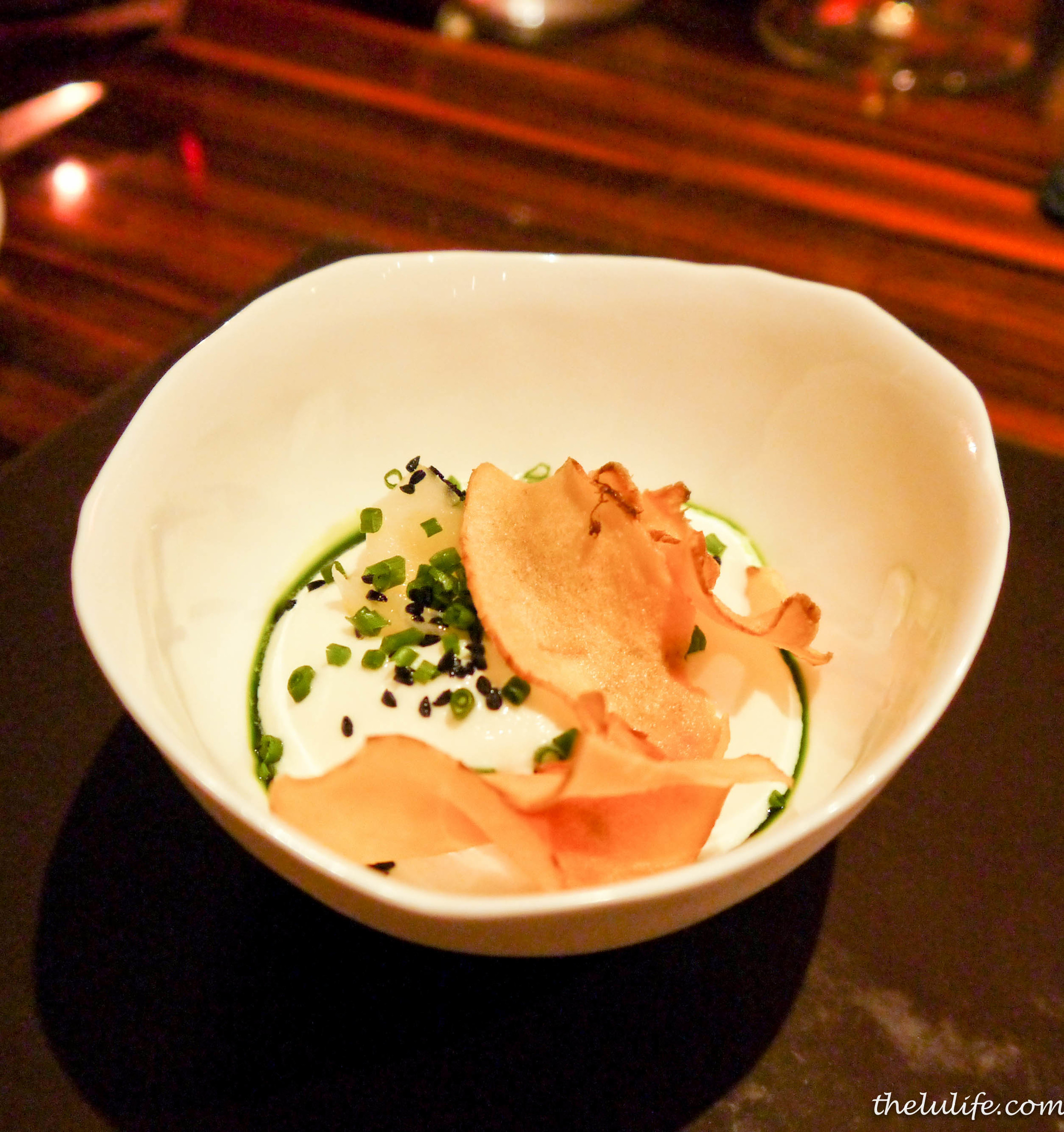 Amuse bouche: artichoke three ways (crisped, poached and pureed) with a lemon confit and topped with chives
