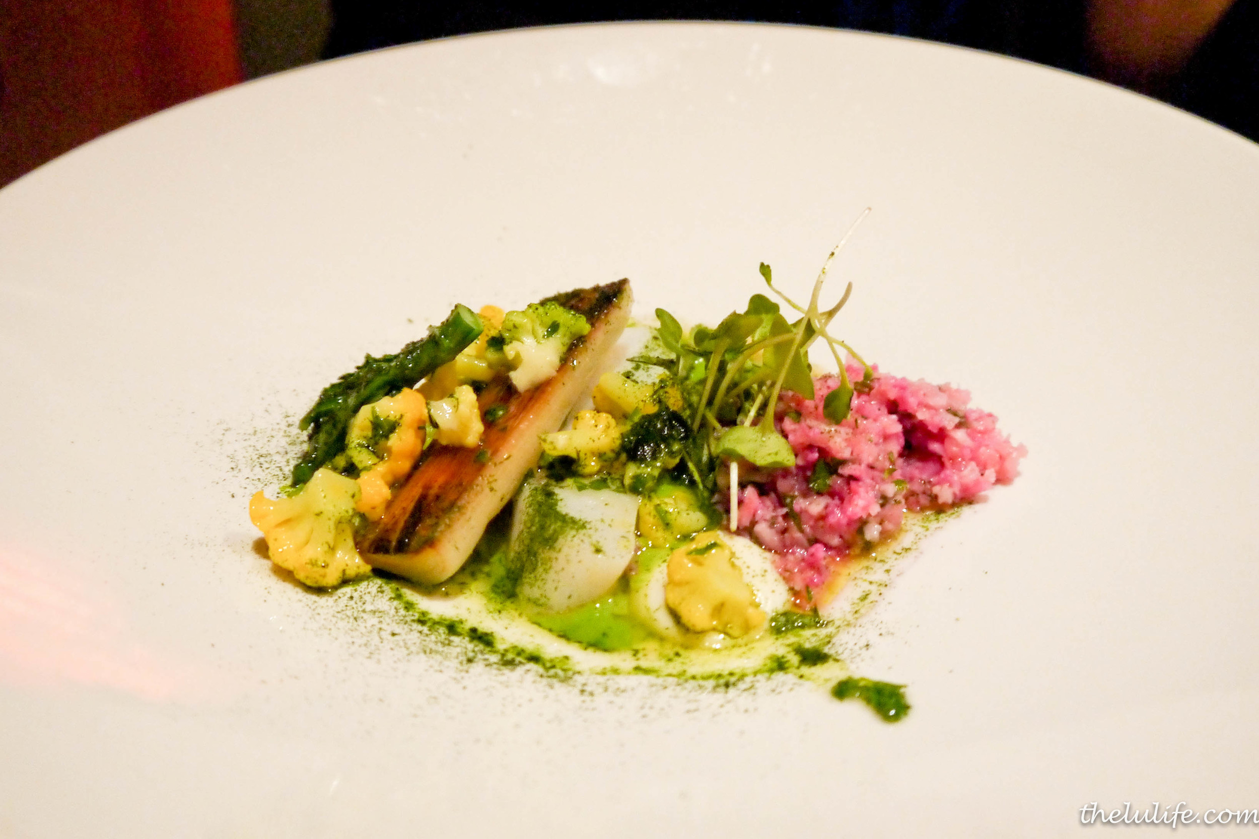 Poached pollock with grilled leak, broccoli, cauliflower and romanesco