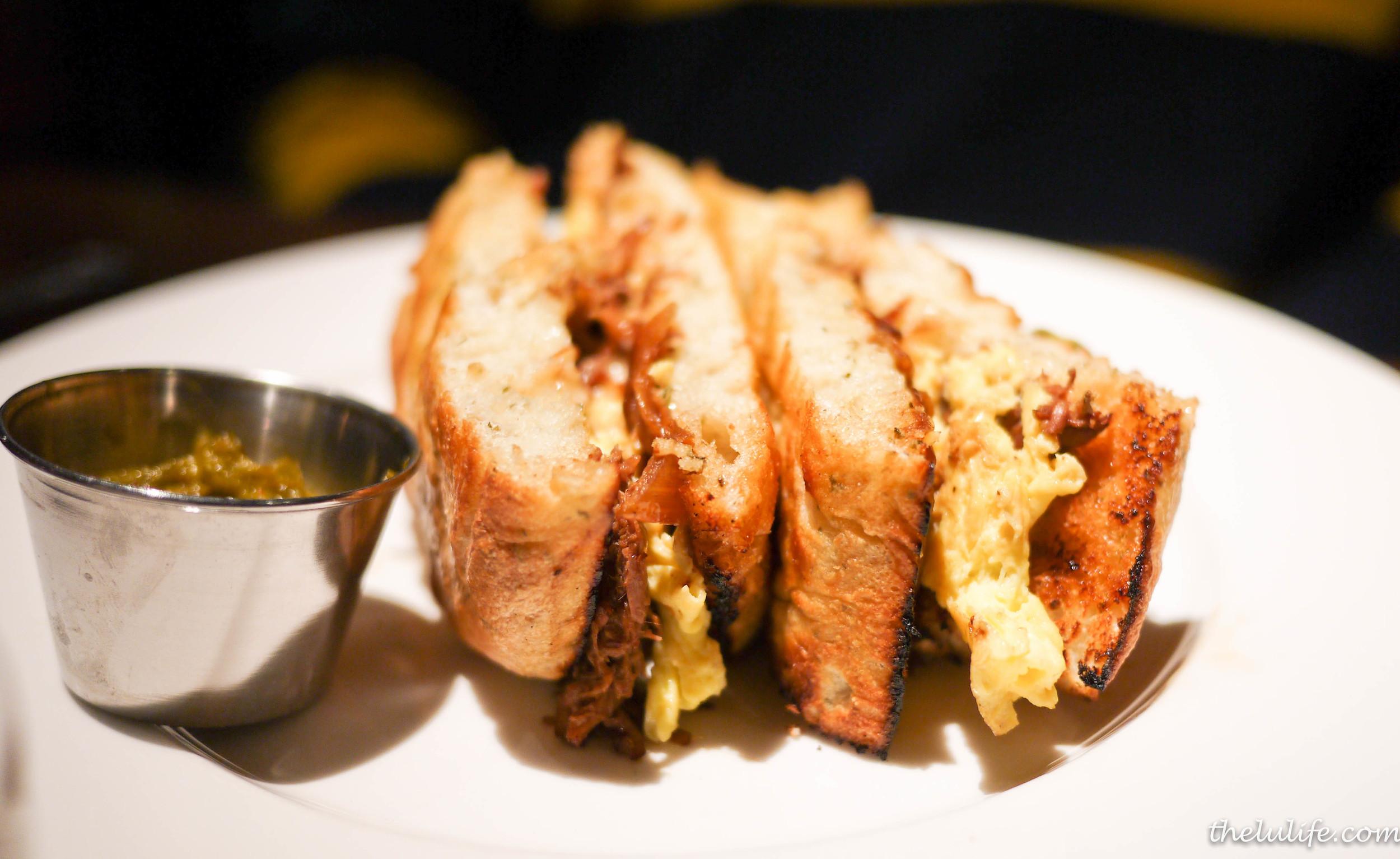 Braised pot roast and egg sandwich - aged white cheddar, jalapeno relish