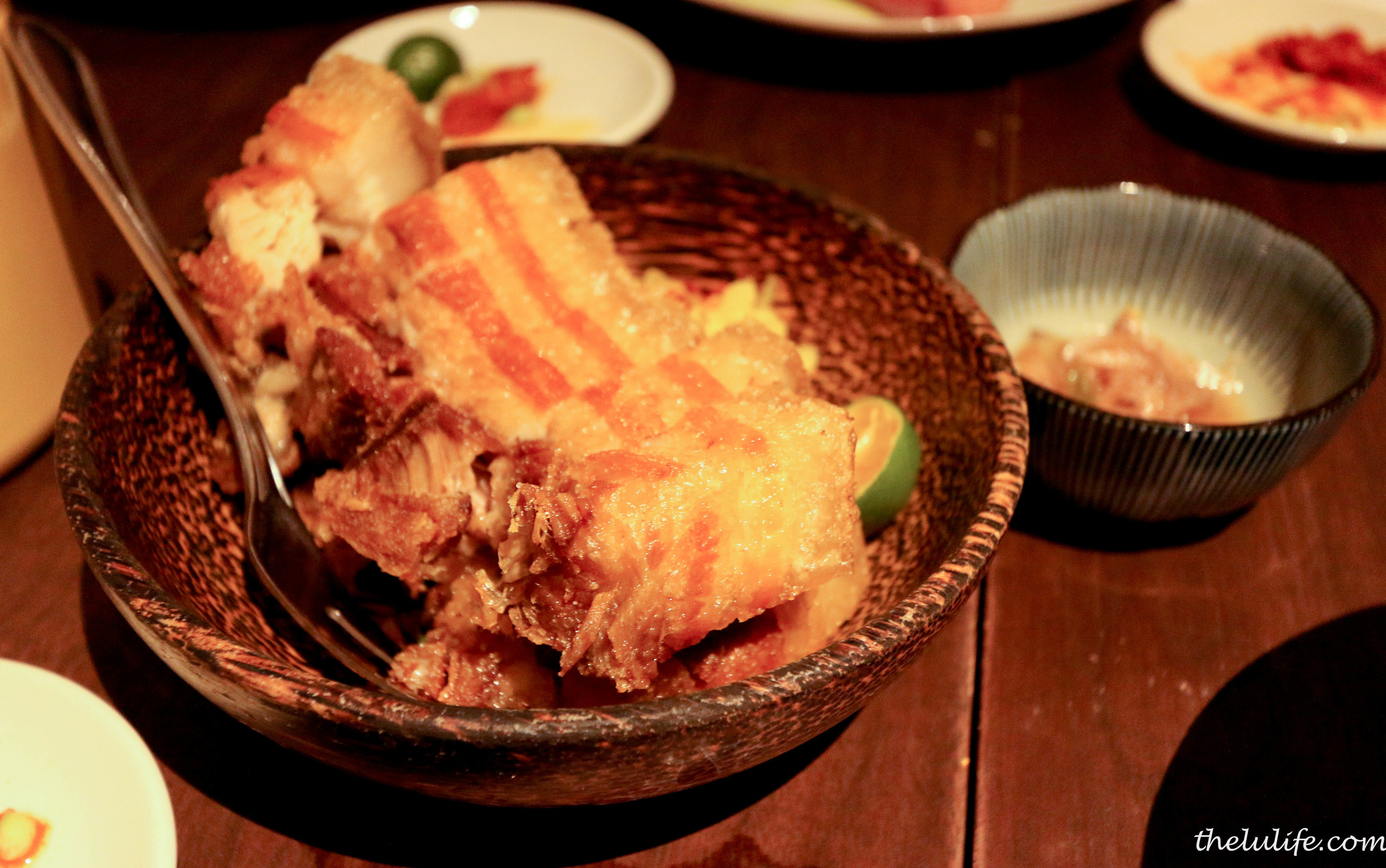 Crispy pork belly with mustard greens, sambal chincalok
