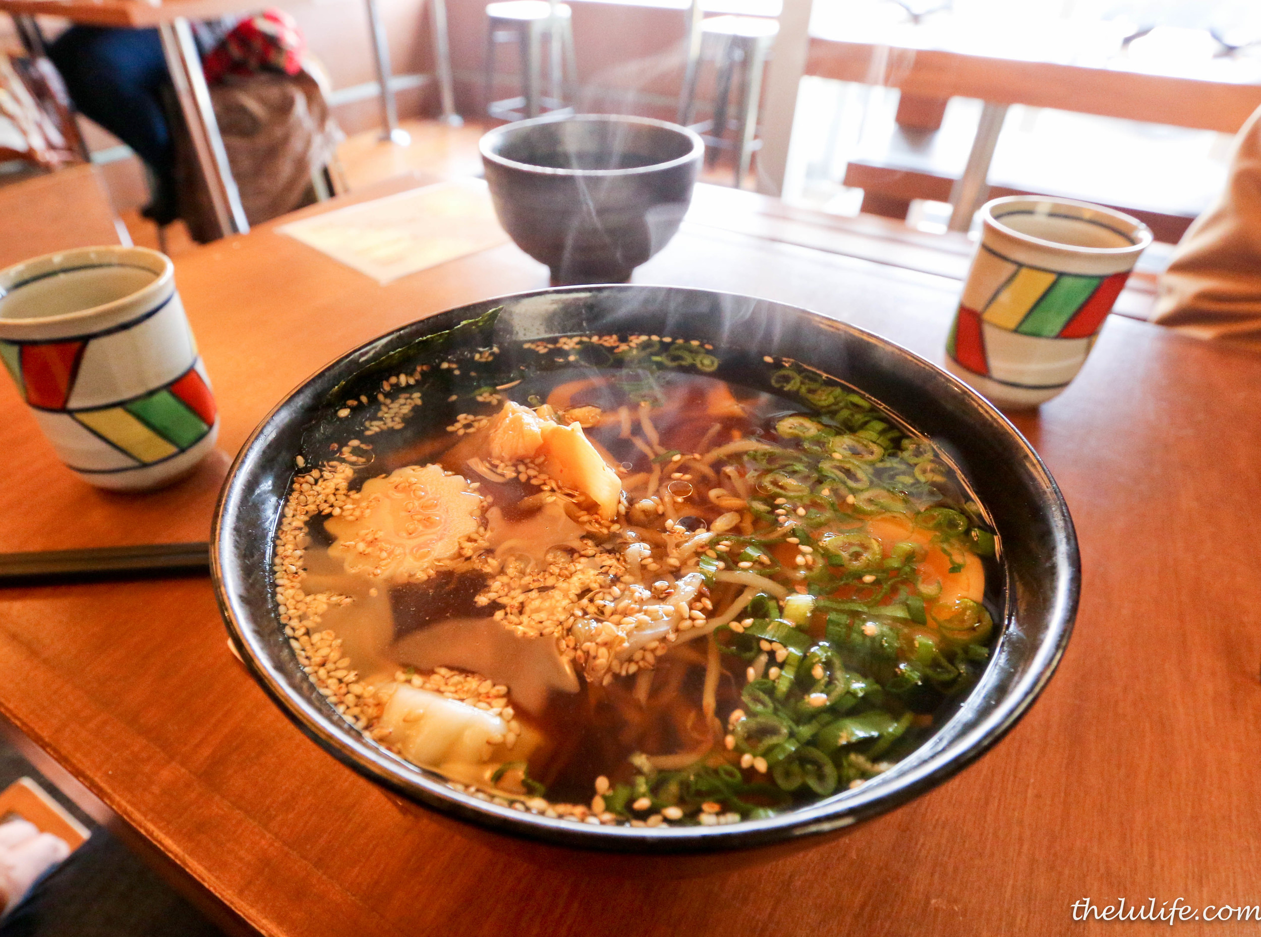 Pork loin kuro buta shoyu ramen: soy sauce and bonito fish broth with menma, scallion, nori, bean sprout, wasabi oil and boiled egg