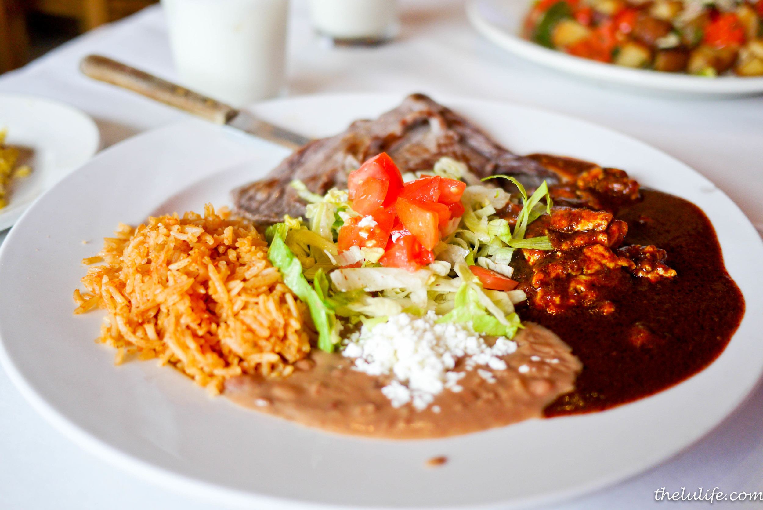 Huevos Campesinos - egg scrambled with onions, tomatoes, jalapenos, chorizo, chihuahua cheese, rice, beans and skirt steak