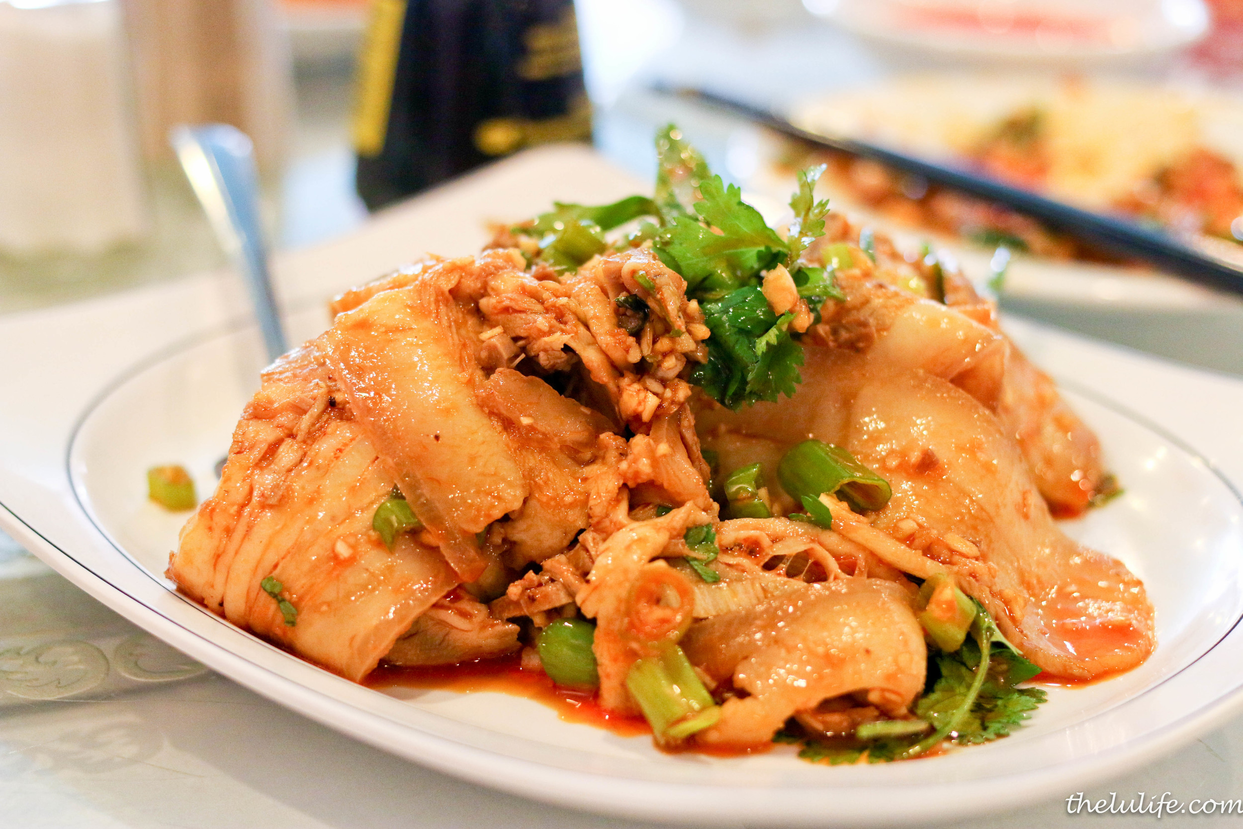 Suan ni bai rou (sliced pork with garlic sauce)