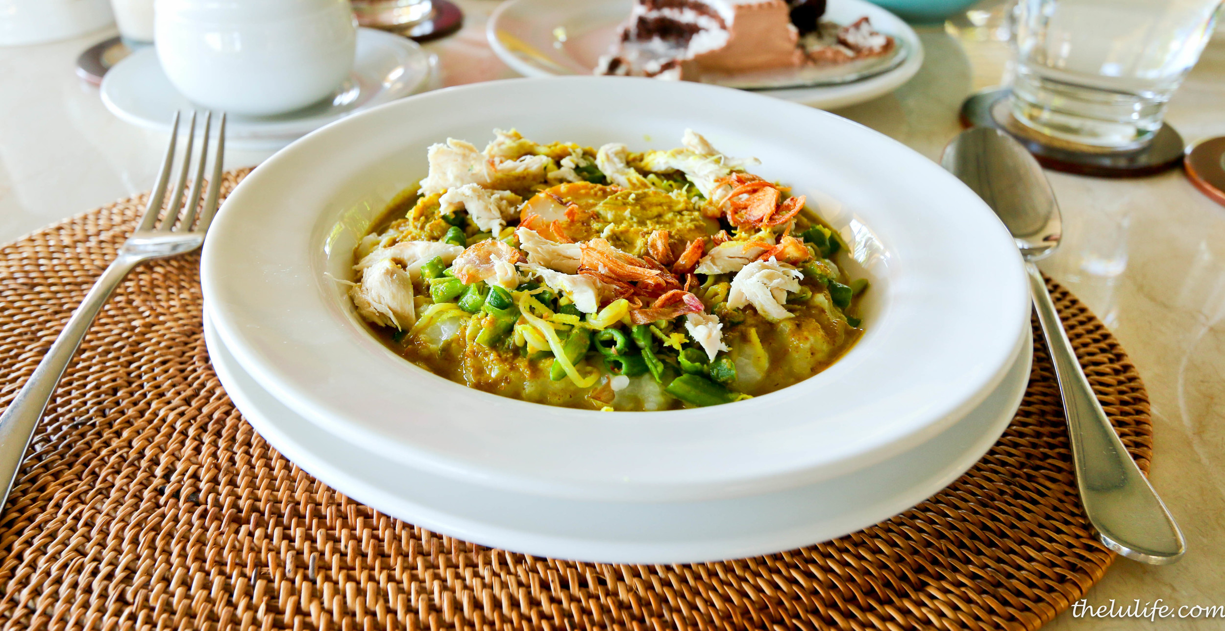 Bubur ayam - traditional Indonesian porridge with shredded boiled chicken, boiled egg, salted vegetable and green chili cutting in light soy sauce