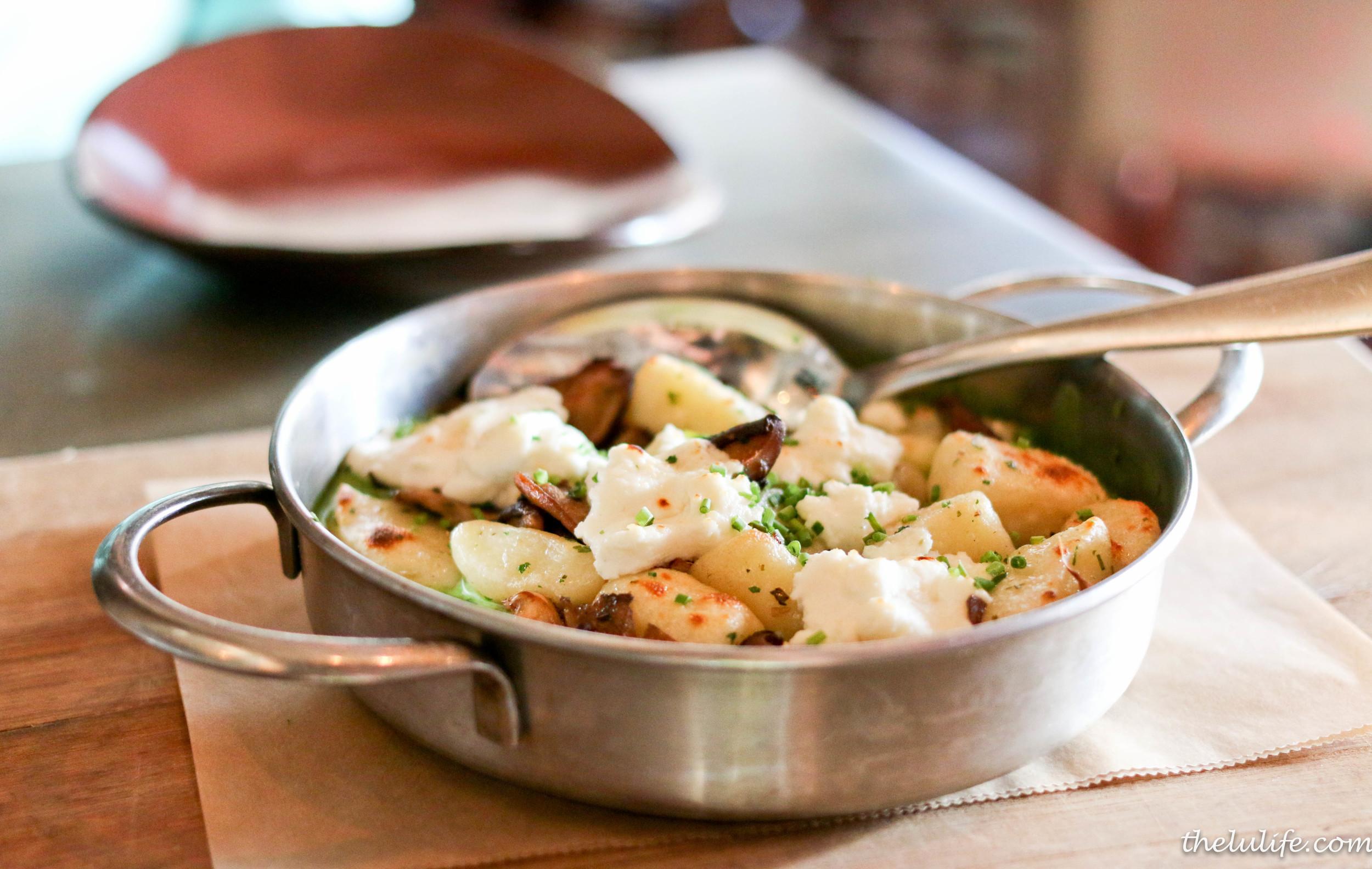 Potato gnocchi with spring mushrooms, stinging nettles, fresh goat cheese