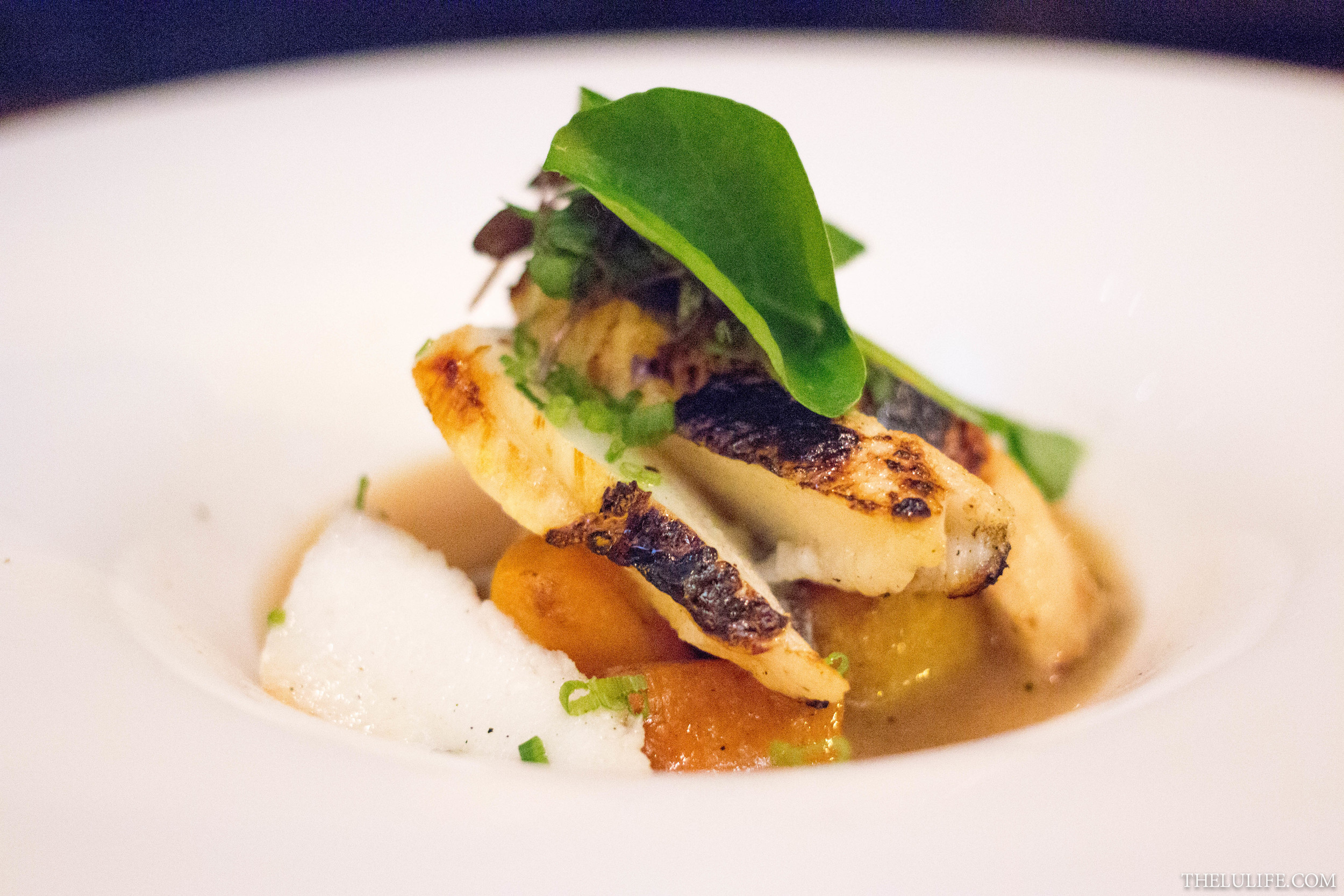 Grilled Chilean seabass with roasted butternut squash and peppercorn broth