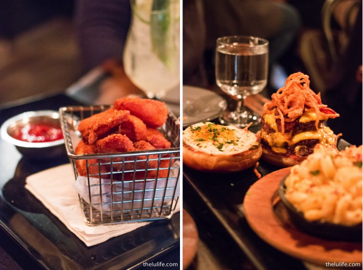Left: Half pound jumbo fried shrimp Right: Wolf burger - three patties with bacon, American cheese, shallot straws, house made pickles, mayo and fried egg