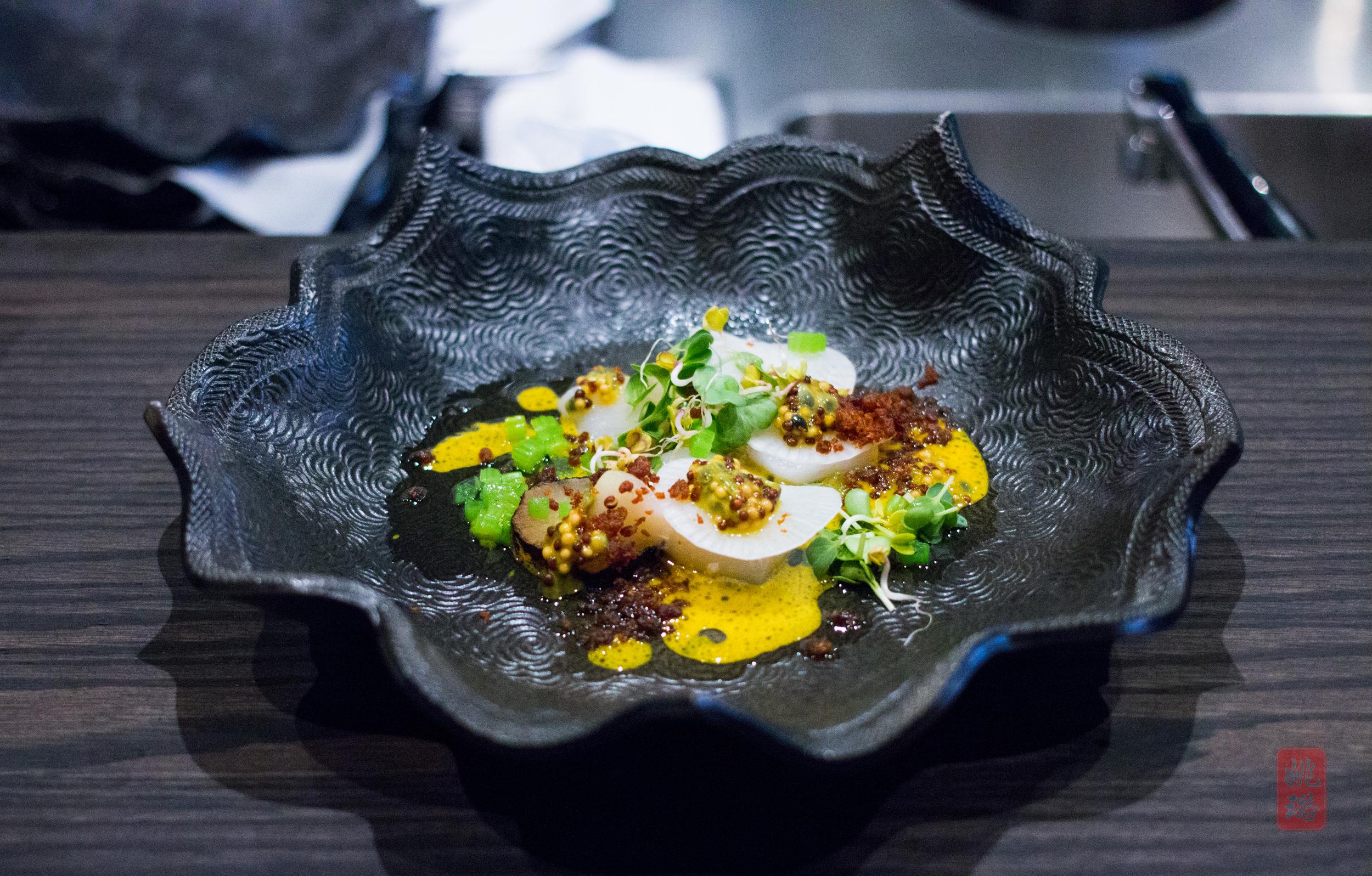 Scallop crudo - mustard, passionfruit, charred daikon