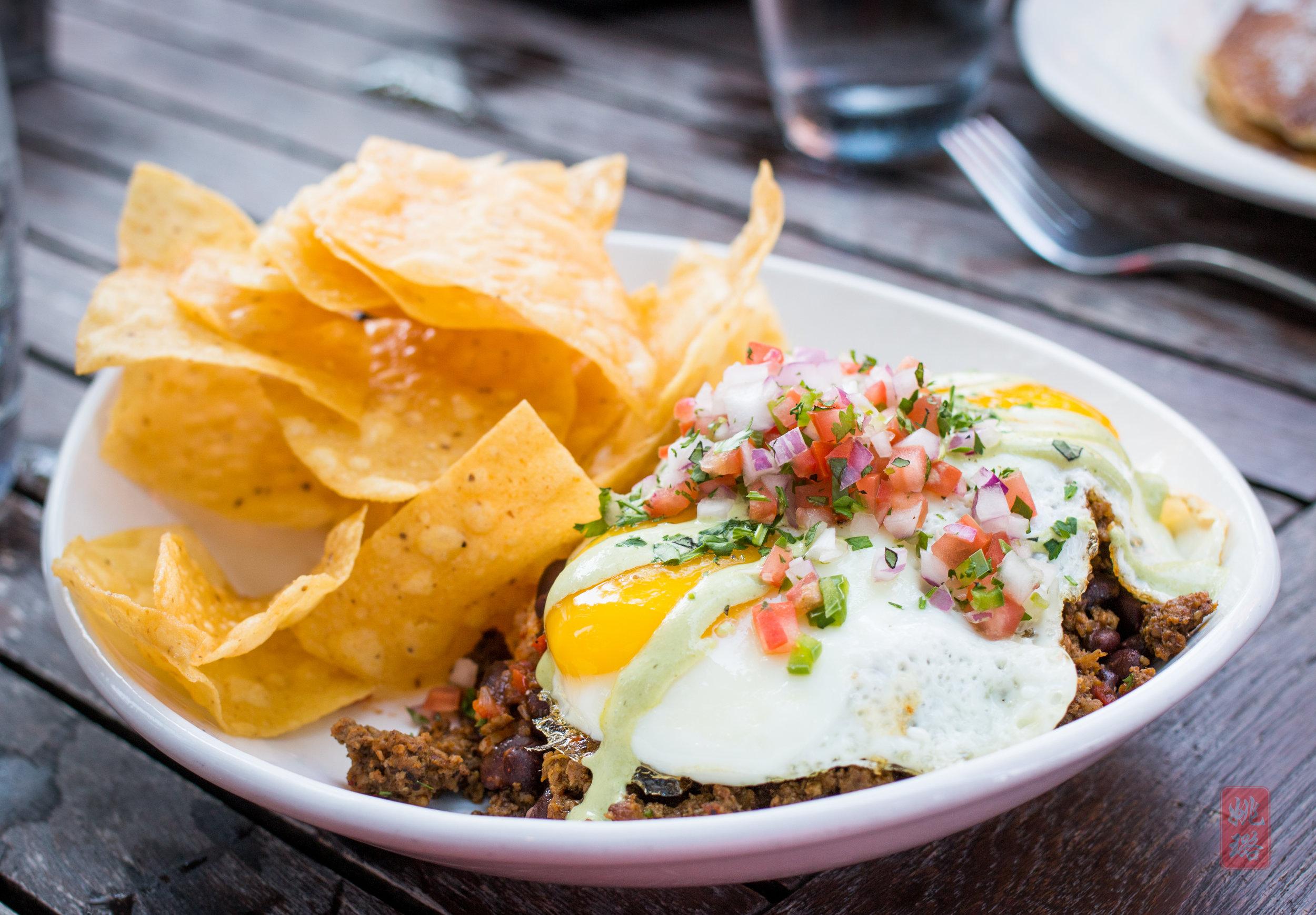 Huevos rancheros - house made chorizo, Mexican rice, Chipotle black beans, cilantro-lime crema with tortilla chips