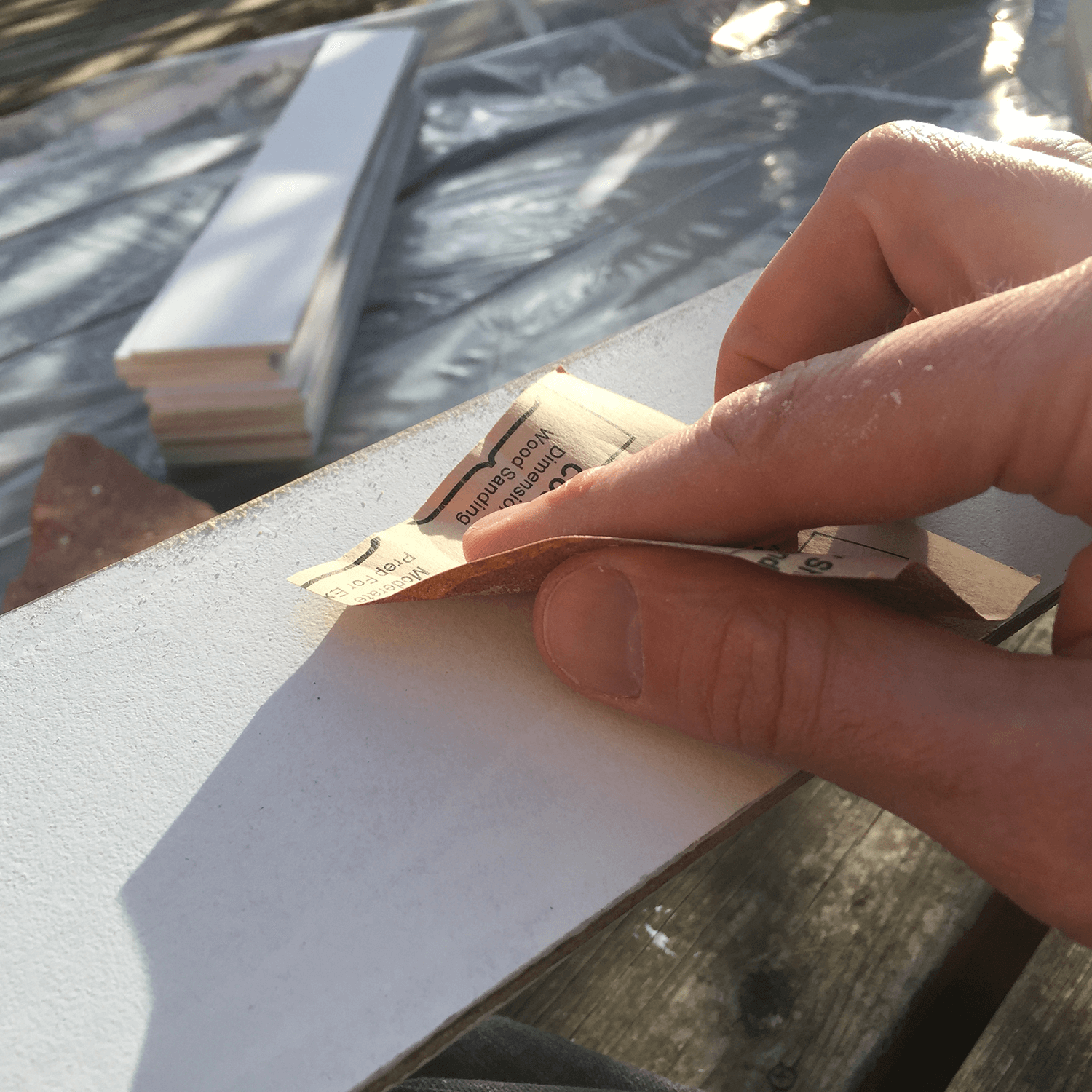 Slats had to be sanded after each coat to keep them smooth enough to slide through the slots in the sign.