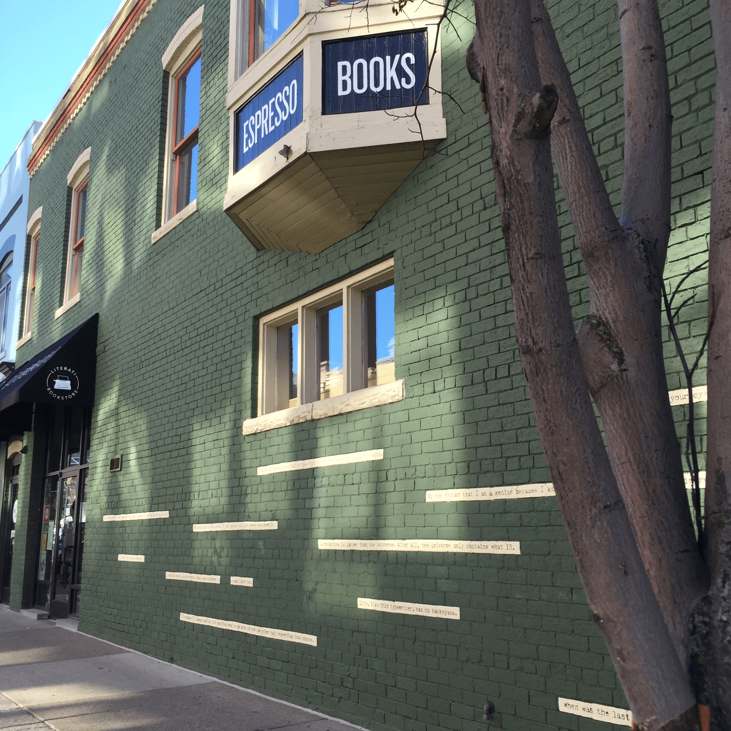 All done: branded awnings, bay window lettering, and a mural