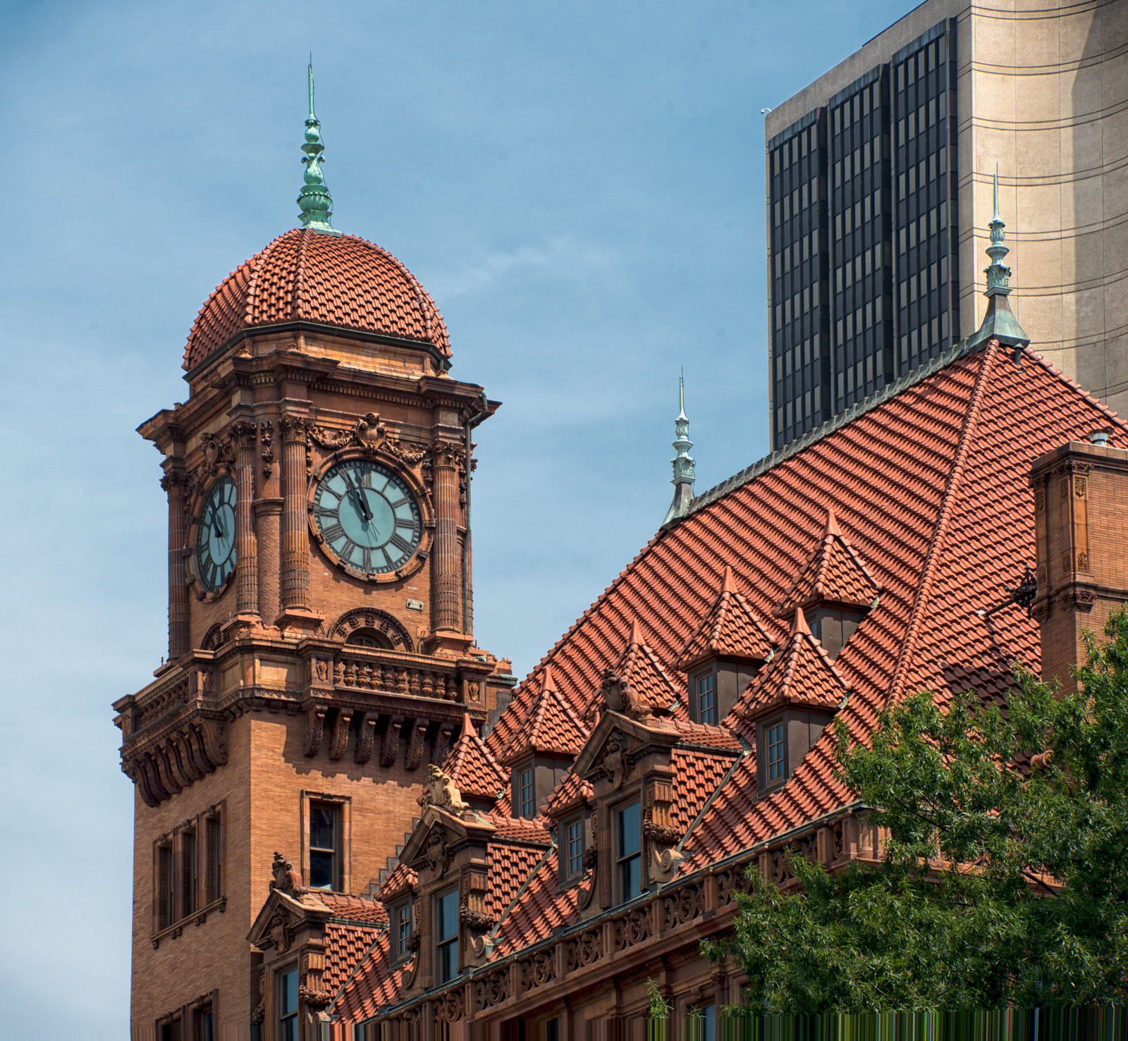 Here's a close-up of the ornate roof and clock tower. The building in the background is the James Monroe Building. It's the tallest building in Richmond, but as contrasted against Main Street Station, it's a mundane and depressing pile of steel, glass, and concrete.