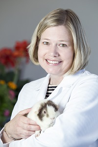 Dr. Carolyn Thorne, owner of Veterinary Services of Westwood, and her guinea pig Cocoa.