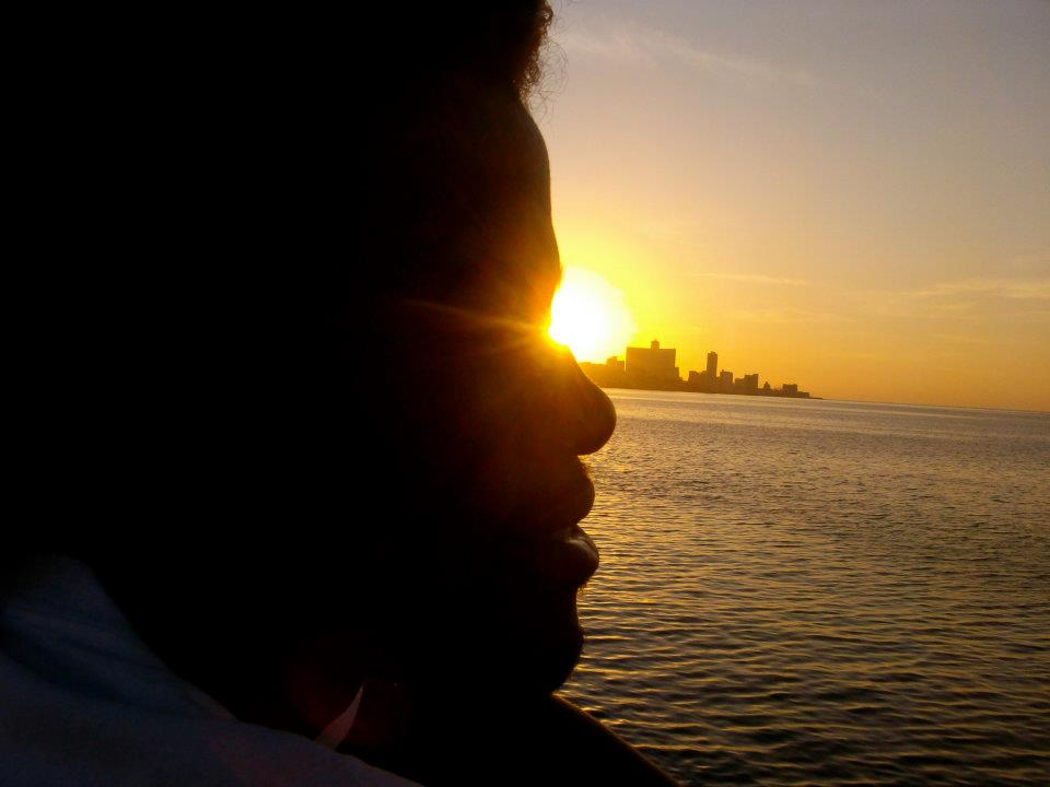 Maddiel watching the sunset over Habana from his favorite spot at the Castillo. Descanse en Paz querido.