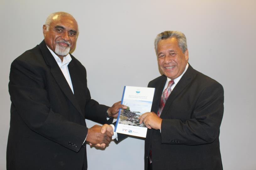 Photo: PASAI Advocate, Mr Eroni Vatuloka handing a copy of the regional report to the PASAI Chairperson, Mr Iso Ihlen Joseph at the launch.