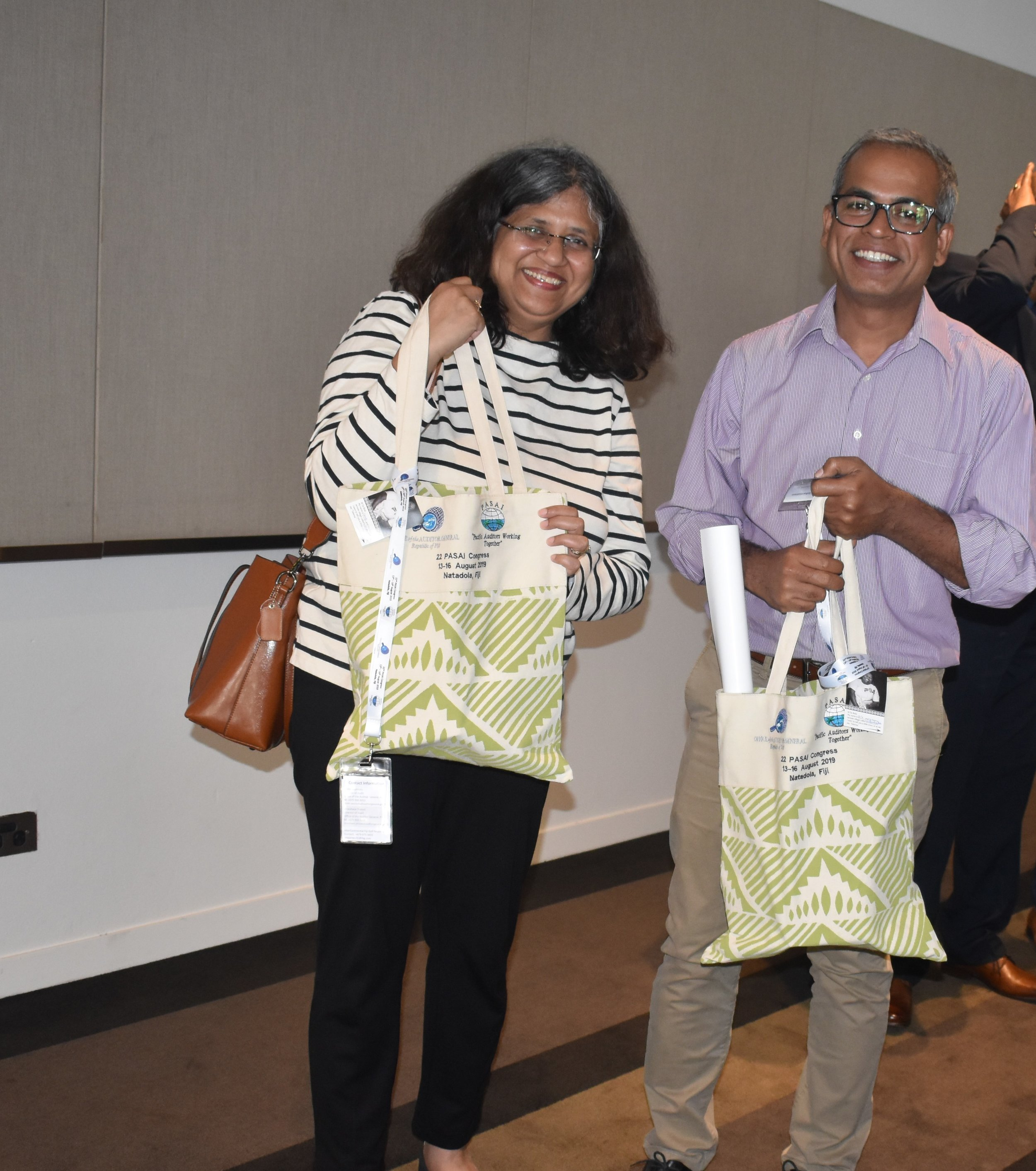 Archana and Shofiq with their Congress welcome bags.jpg