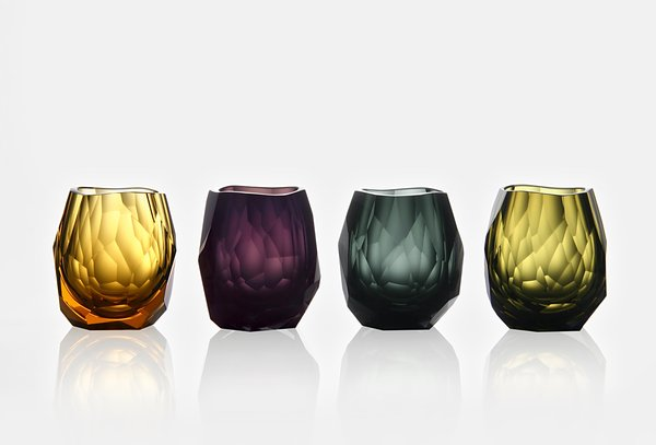"This unique glass features the bold profile and multifaceted surfaces of the Glacier motif, designed by the American designer David Wiseman. Although its shape has been carefully designed to retain the aroma of whiskey, it also makes a beautiful votive candleholder – especially in vibrant colors like purple, amber, and smoke.  The smaller version of the crystal glass is the perfect sipping vessel for a spectacular tequila-specifically Casa Dragones. The weight of the crystal is a nice balance to the 100% pure blue agave silver tequila that boasts a light, crisp finish. ""Coast to coast LA to Chicago""-serve your drinks in style.  ~Suzanne  At Bernadette Schaeffler Collection 1616 Hi Line Dr Suite 100, Dallas, TX 75207 (214) 749-0816"