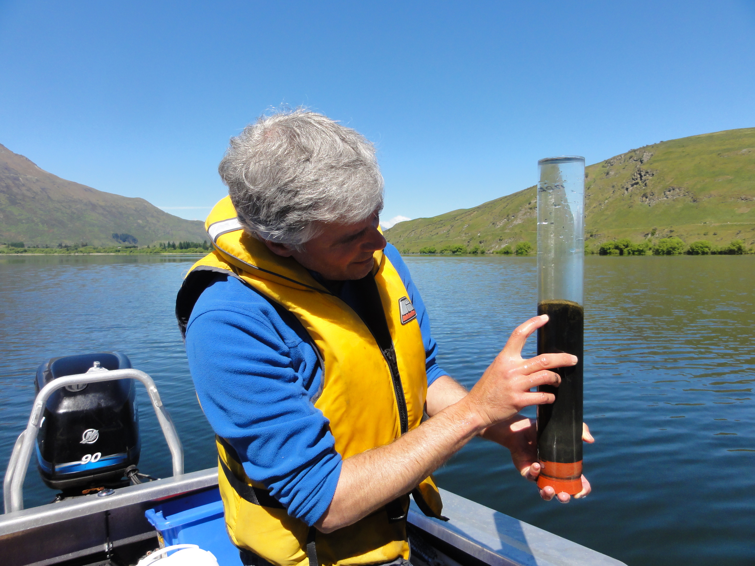 Examining the sediment-water interface of Lake Hayes.    Photo courtesy of Marc Schallenberg