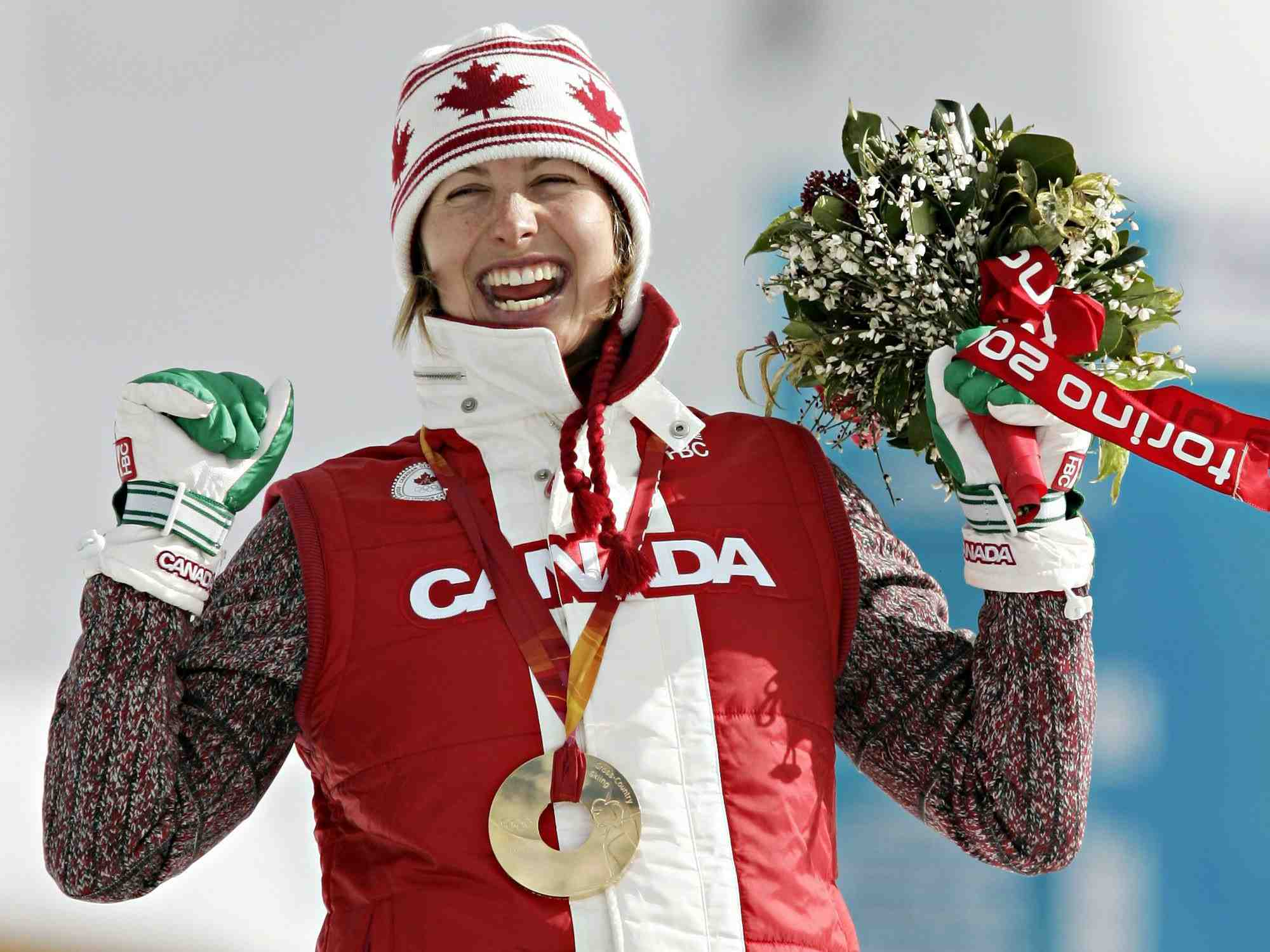 Cross-country skier Chandra Crawford of Canmore, Alta. celebrates her gold medal win in the women's sprint in Pragelato Plan, Italy on Wednesday, Feb. 22, 2006.(CP PHOTO/COC/Jonathan Hayward)