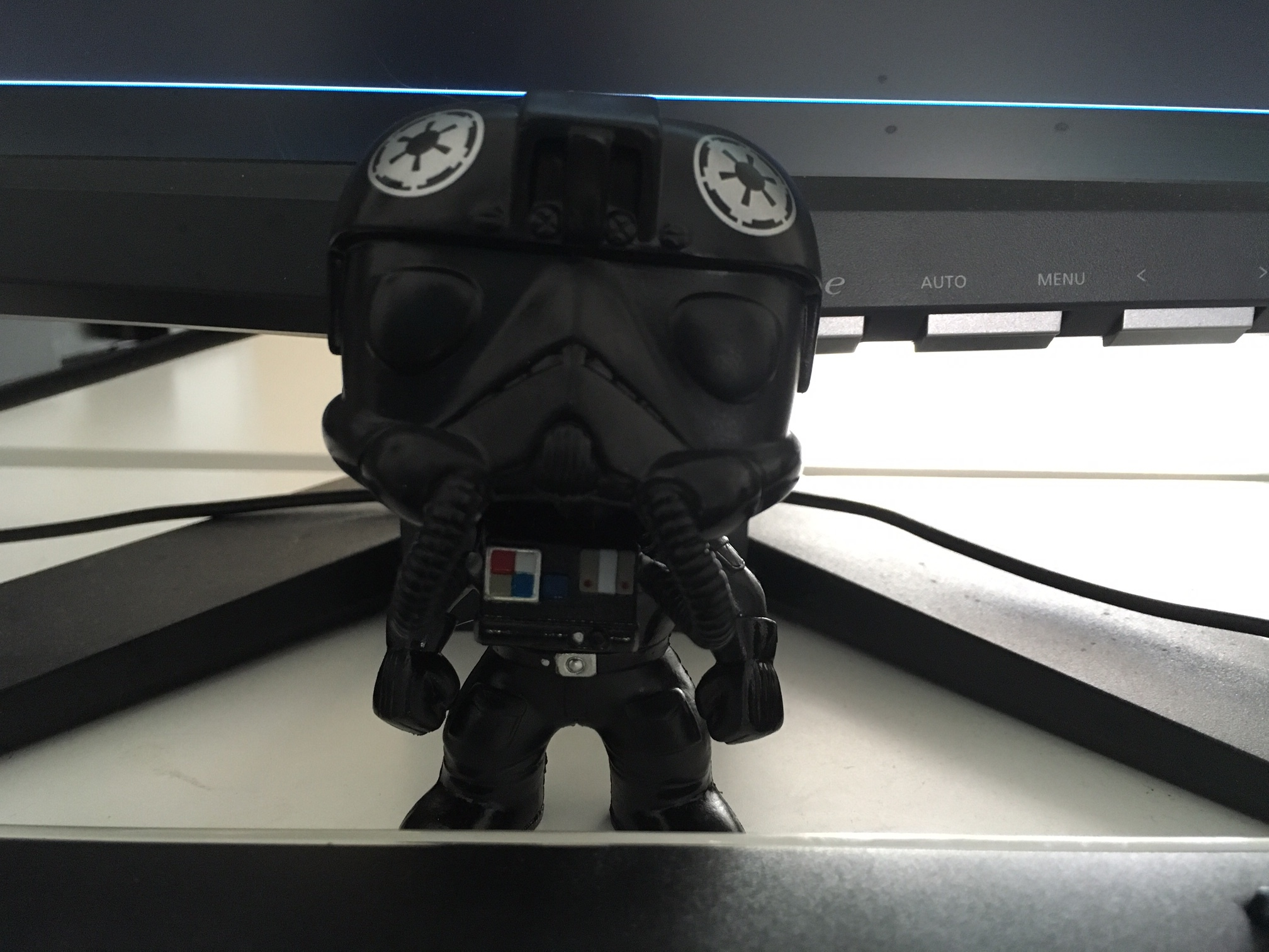 Imperial TIE pilot Funko Pop. His name is Vents because his breathing tube was broken and had to be repaired. I love you all the more for coming to me a little busted up, Vents.