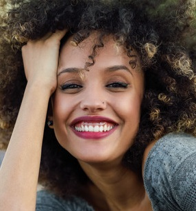 GumRe-contouring - If your gum-line is uneven, or your teeth look very short because they are covered by too much gum, gum re-contouring can be an easy and effective way to correct the problem