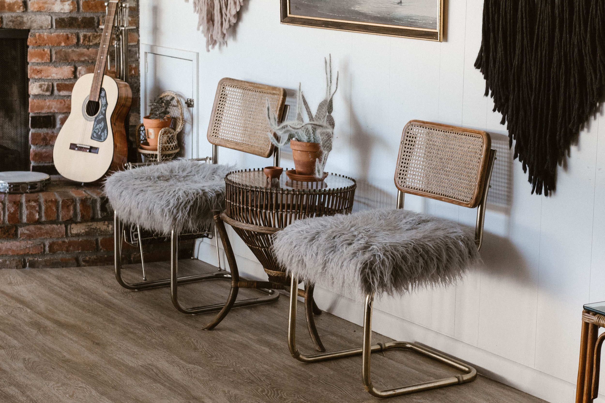 Janis and Joplin - (2) Vintage cane back fur covered cantilever chairs