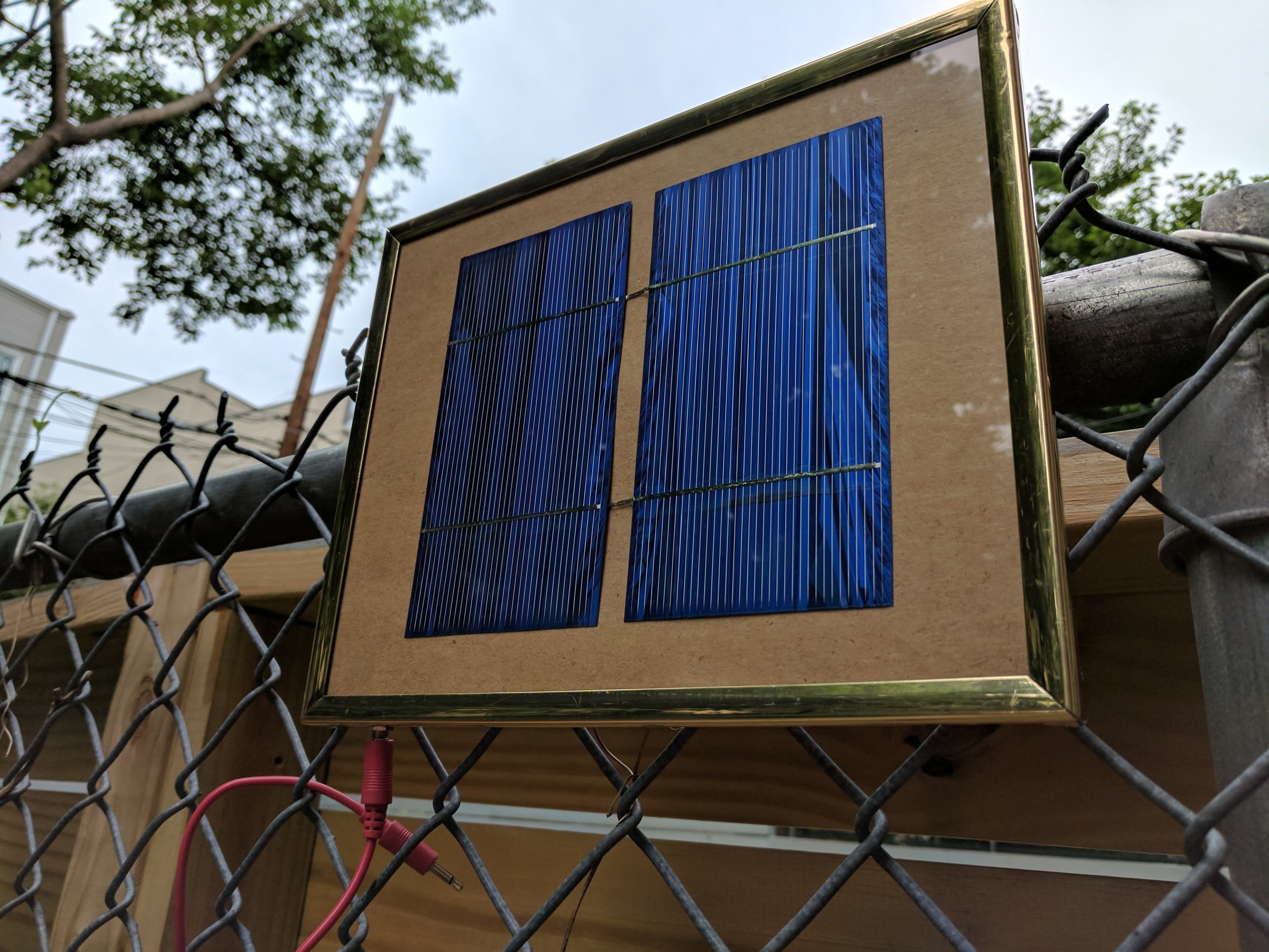 Two solar panels framed with output to a 3.5mm jack.