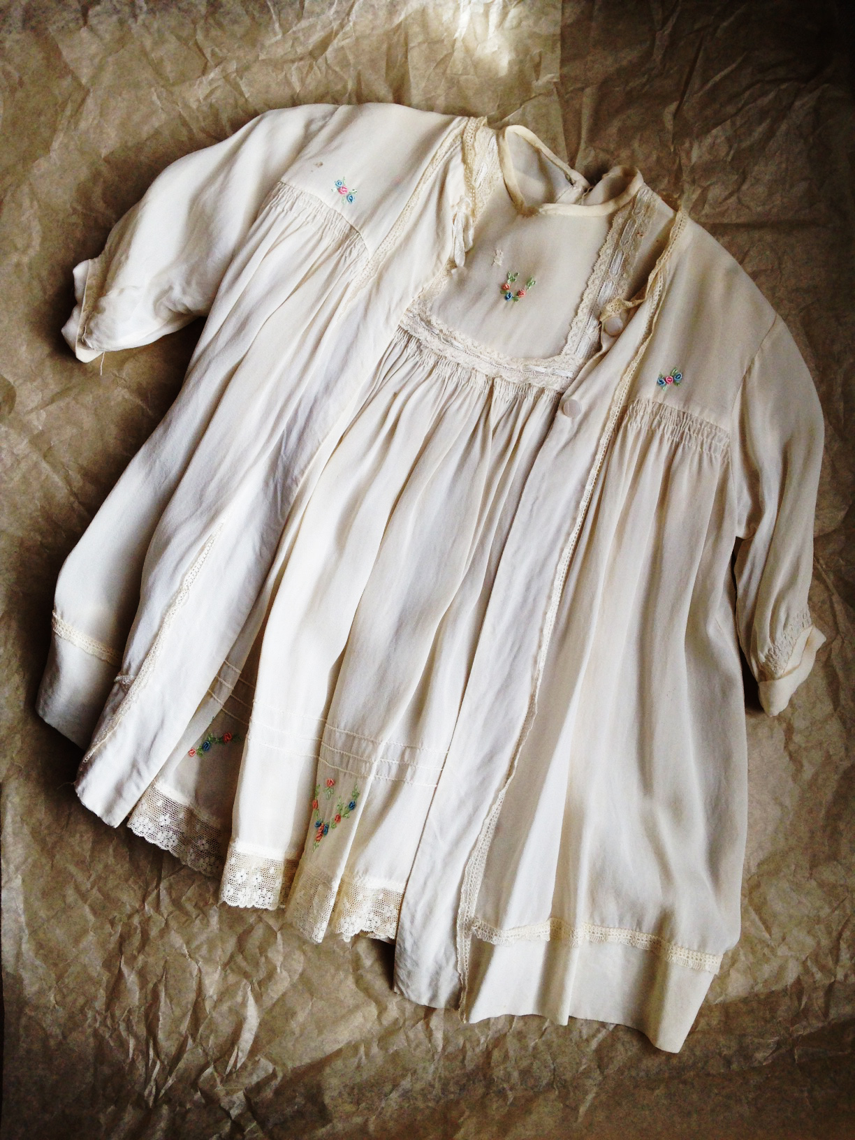 My christening 'gown' (as they were known then) - aged silk, hand smocking & rosebud trimmed. Definitely 'vintage'.