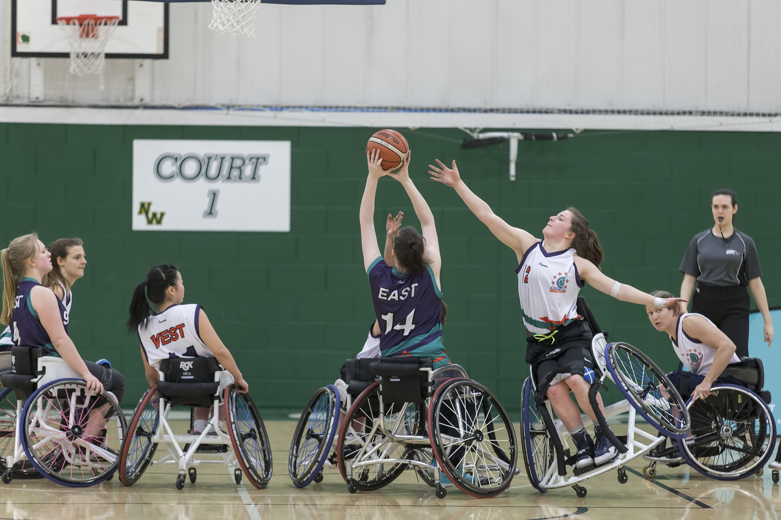 On one wheel - Mowenna putting everything into defence representing Team West at the 2016 BWB Women's League All-Star Game; photo credit SA Images