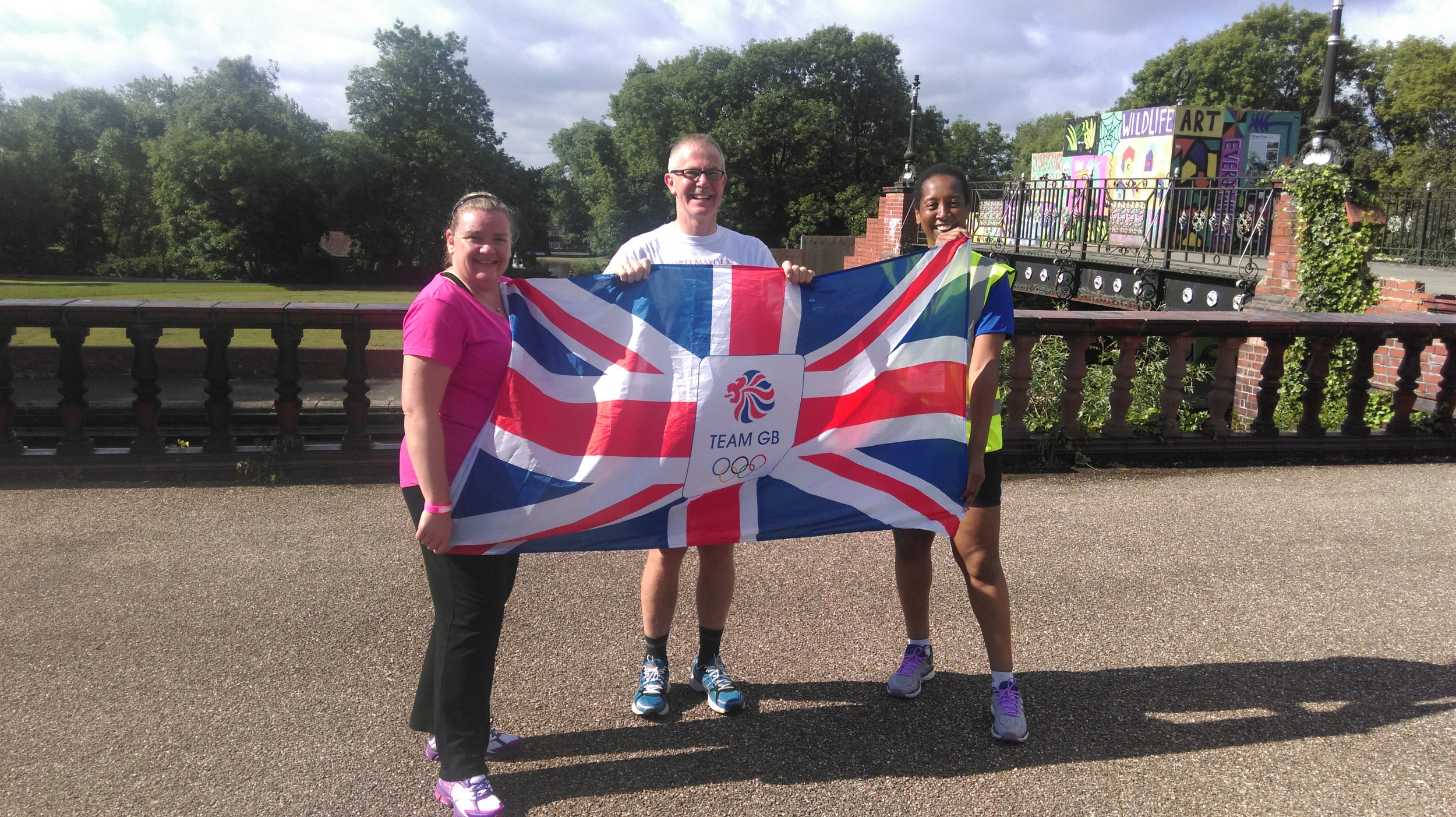 Lord Mayor Anthony Munday supporting TeamGB, with help from Hanley parkrunners