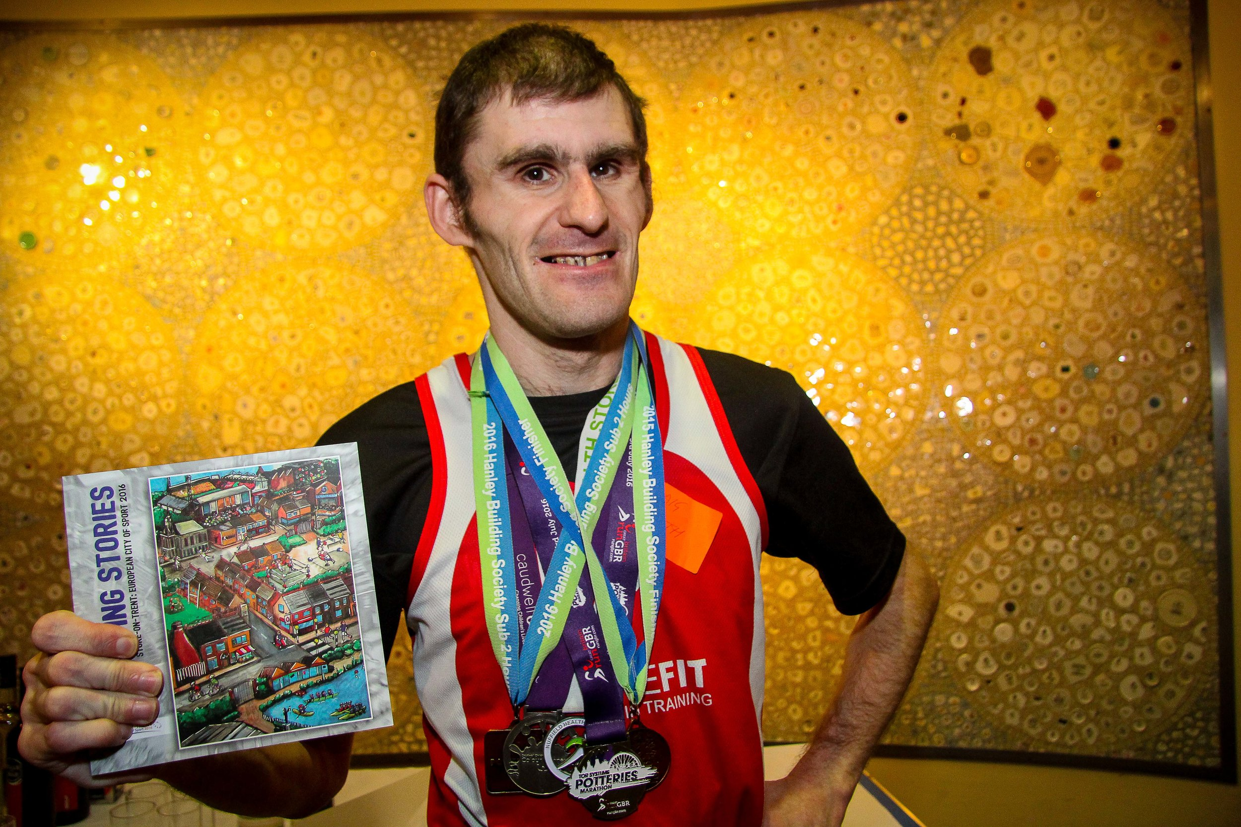 Craig, StokeFIT runner, Vale supporter and author, with a great Potteries medal collection!