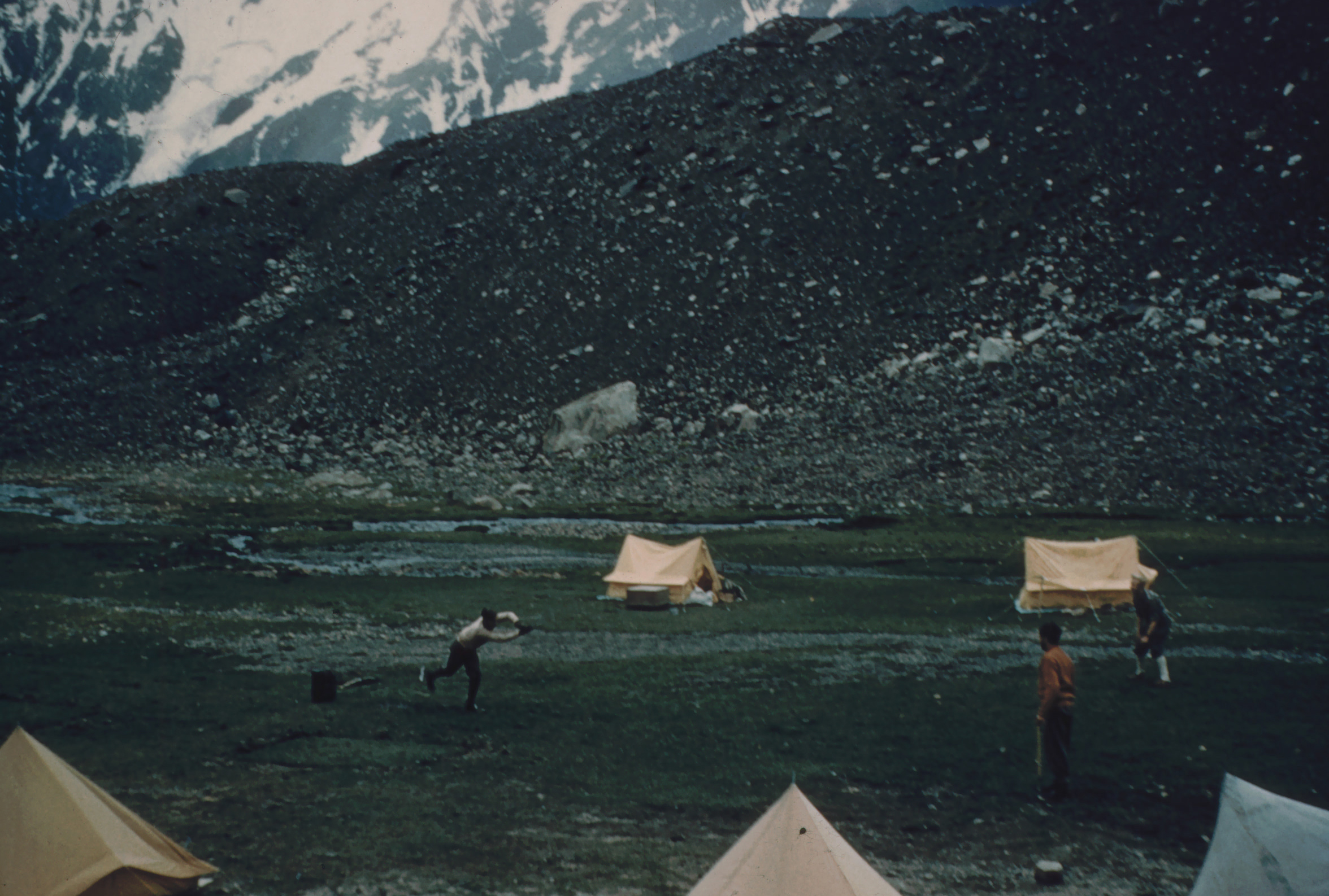 Cricket at base camp with colleagues & porters. Ted is the batsman (photo from Ted Norrish collection)