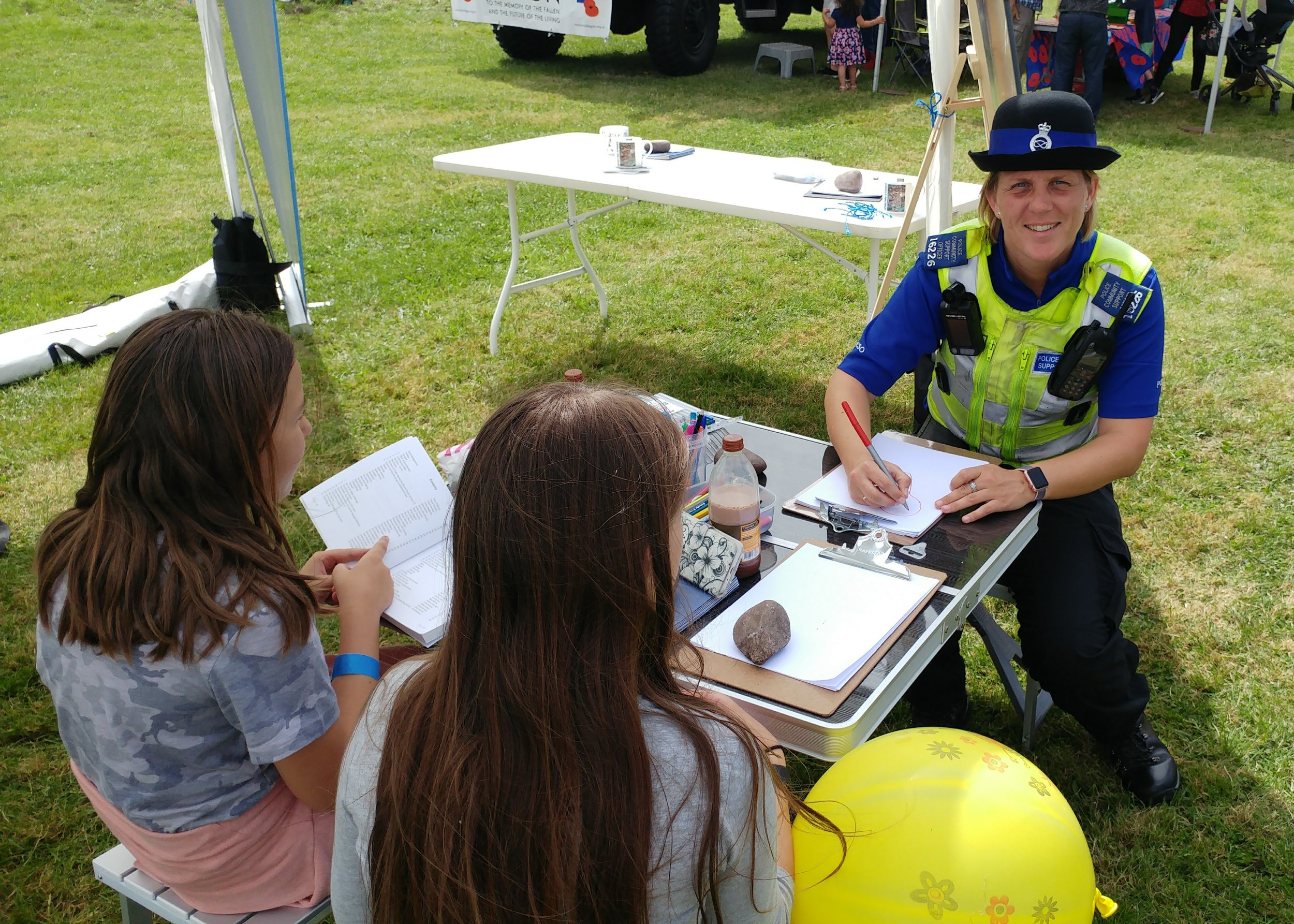 A good sport! PCSO Knight from Longton Police Station joining in the fun at Hanford Park