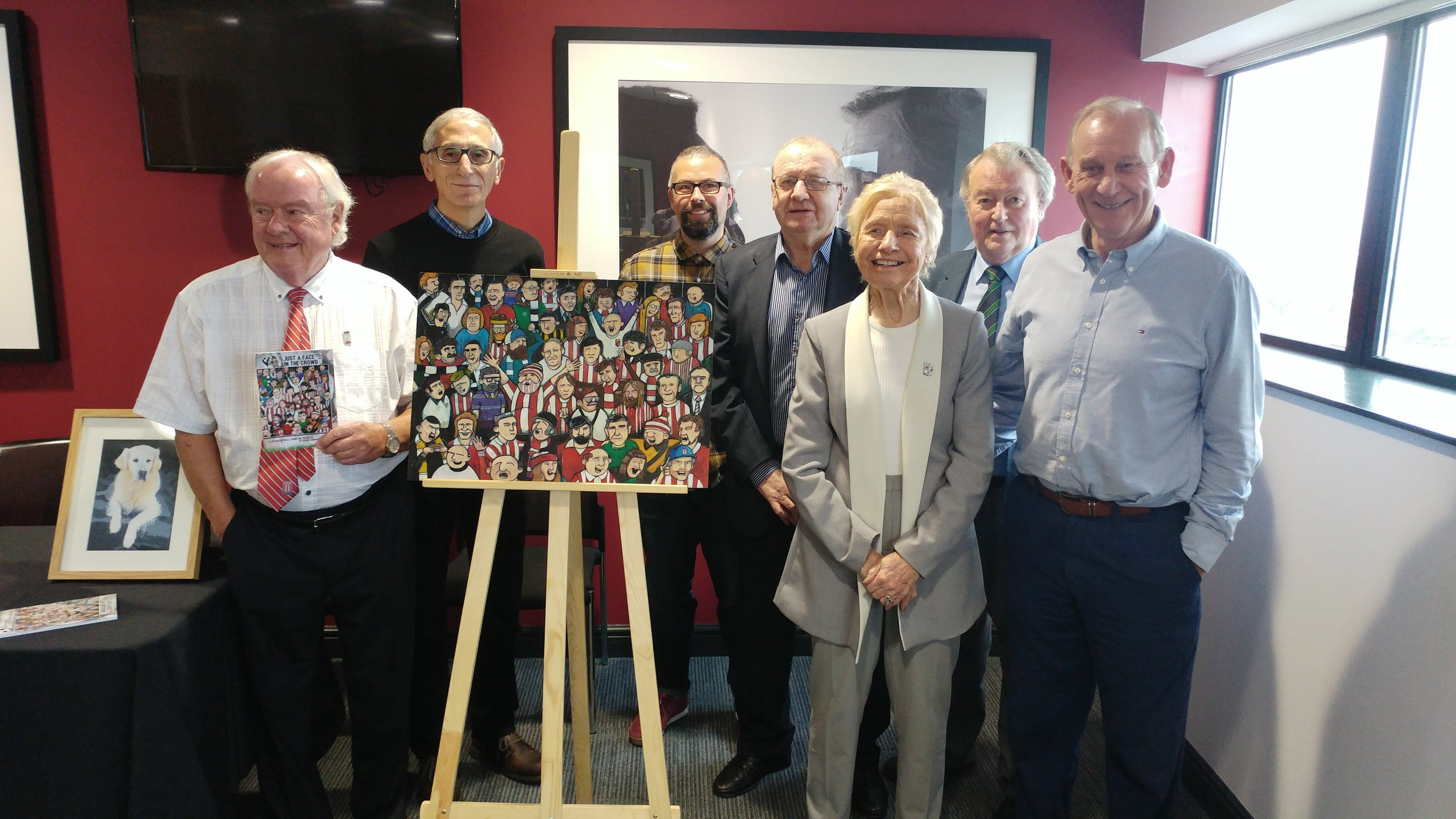 (l-r) Roger Horwood, John Ruggerio, Gaz Williams, Terry Conroy, Jean Gough, Nigel Johnson and Denis Smith, with the original painting fro the cover artwork.