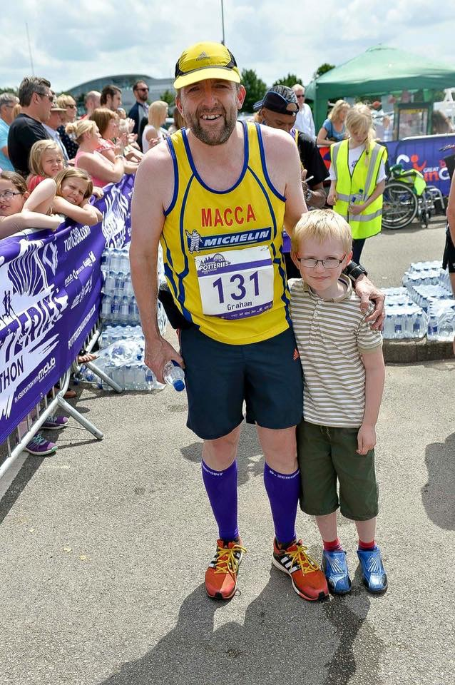 Graham at the finish of the Potteries Marathon, with son Connor. Photo by Mick Hall