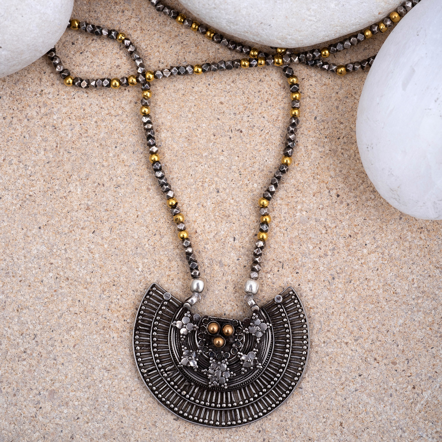 Silver and Gold Gujarati Necklace. Inspired by the wonderful shape of an ancient Gujarati nose ring.This is silver embellished with little gold balls.