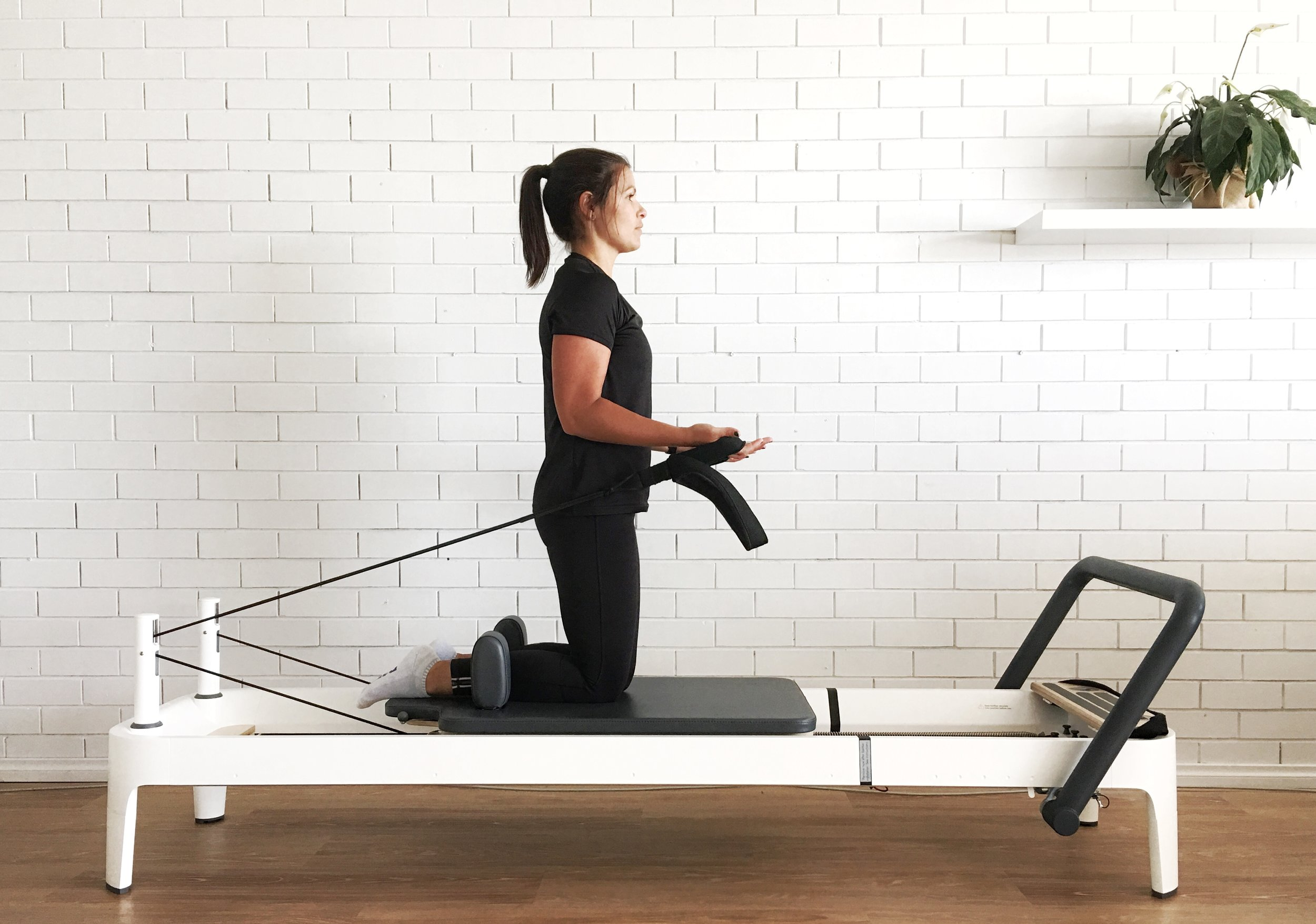 Physiotherapist  Karla  demonstrates a Pilates  Bicep Curl