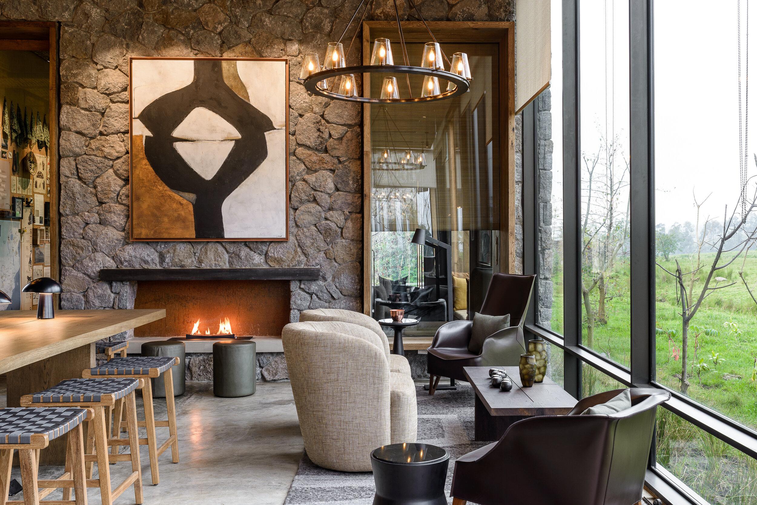 Singita-Kwitonda-Lodge-Lounge-Area-with-Fireplace.jpg