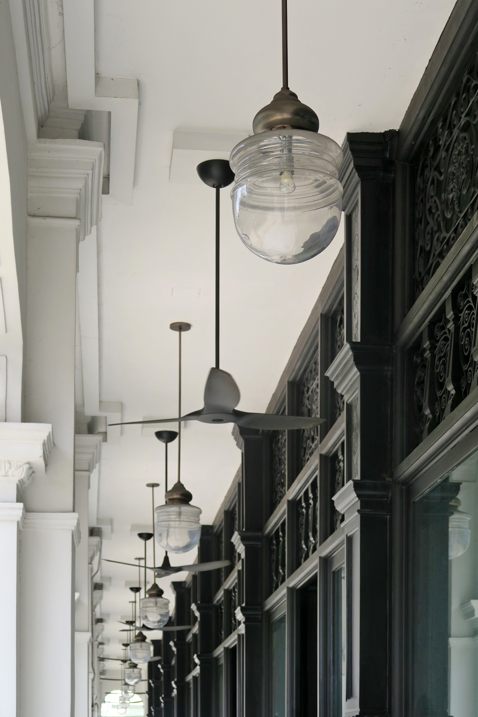 Fans and lamps along the corridor of Stamford House