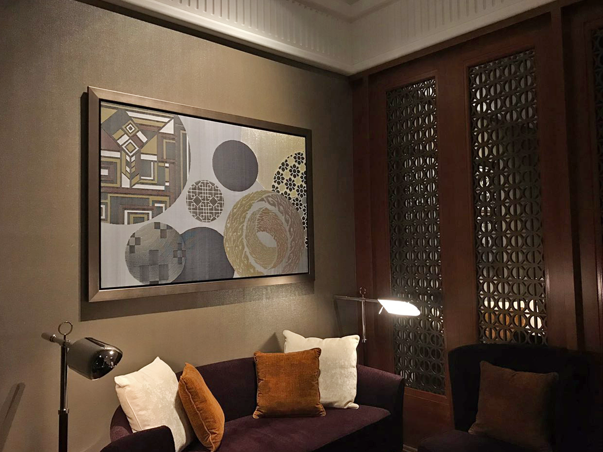 Completed songket artwork hung at the lobby lounge, mirroring the art deco design of the hotel and the multicultural spirit of Singapore.