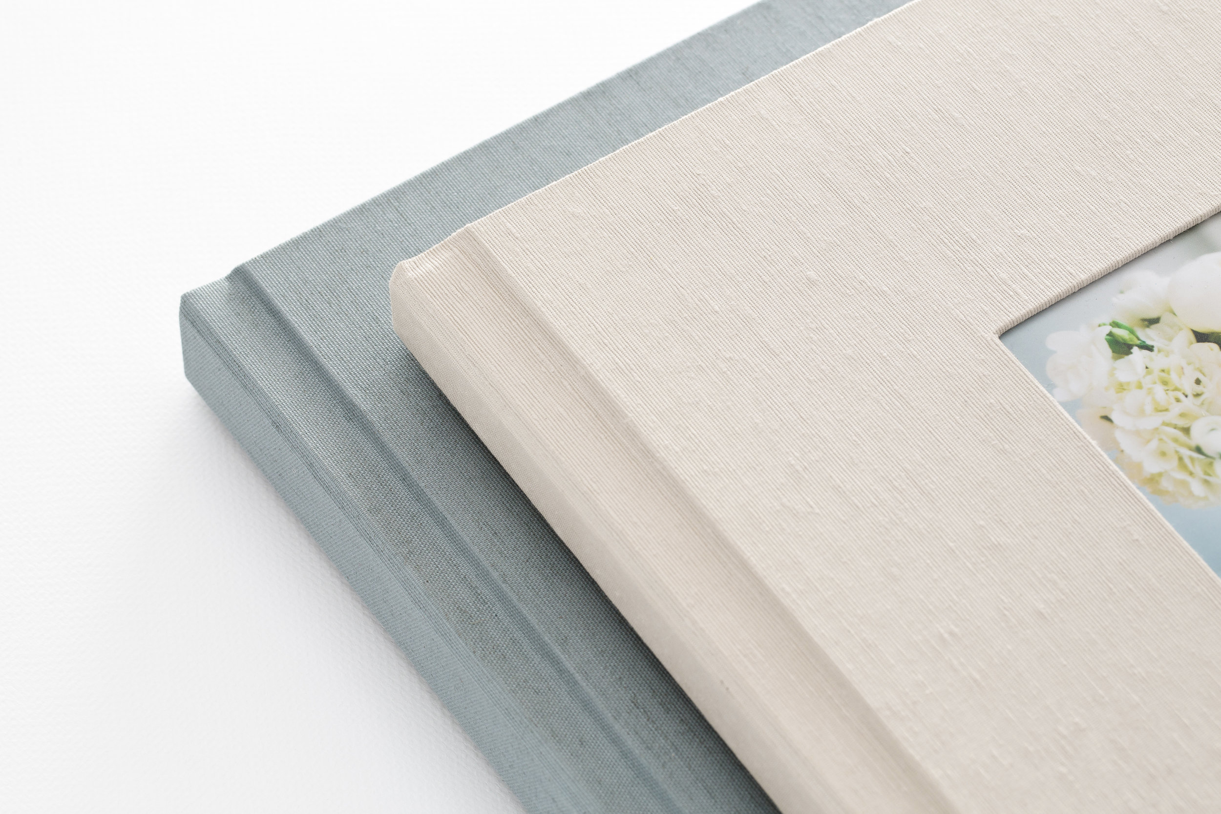 Fabric - Create an elegant heirloom album with one of our luxe linens or Japanese silks. Choose from a premium selection of rich colors and textures.