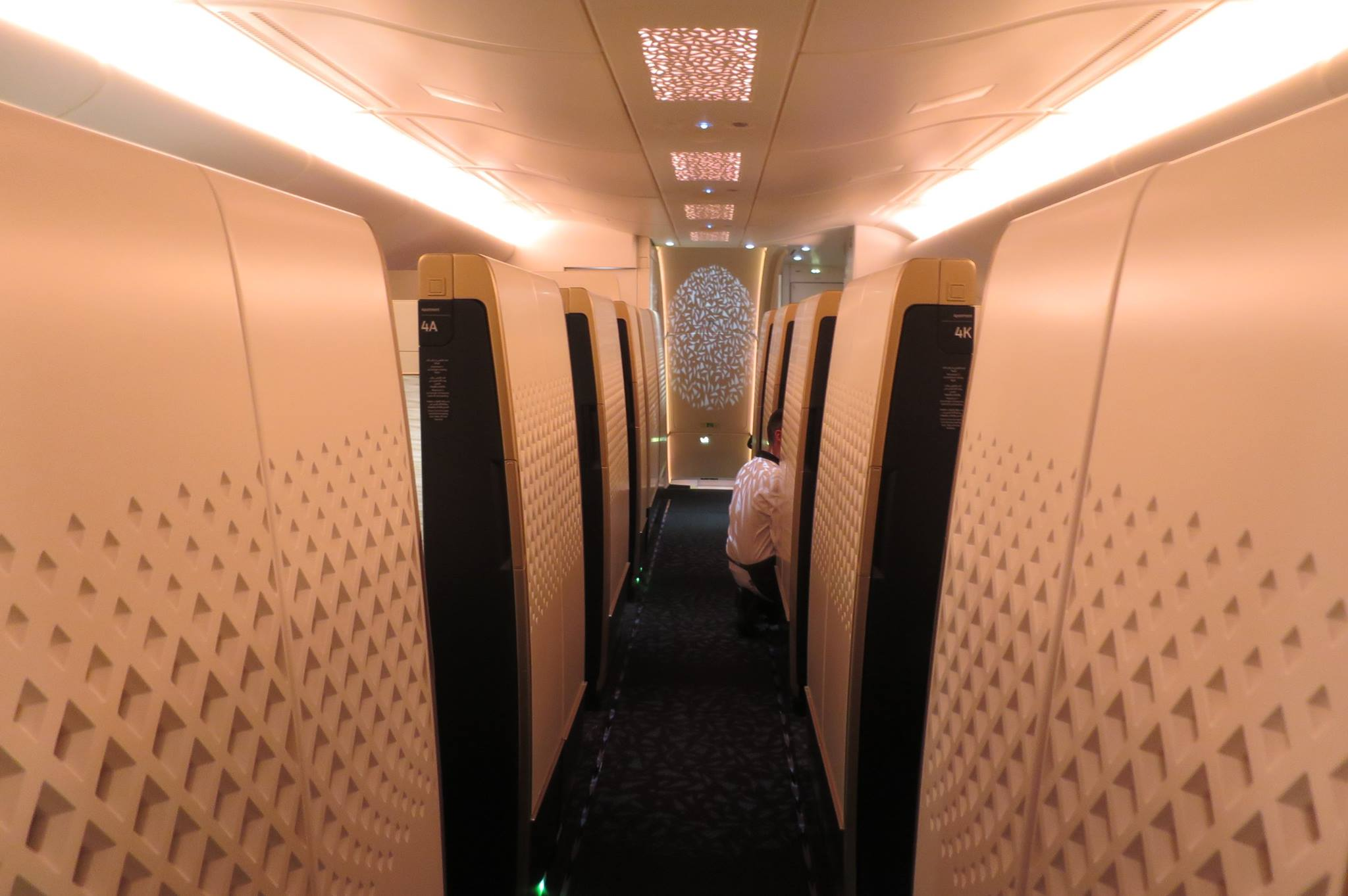 One central aisle in the first class section. Apartments to either side. The Residence to the left in the front. Shower to the right