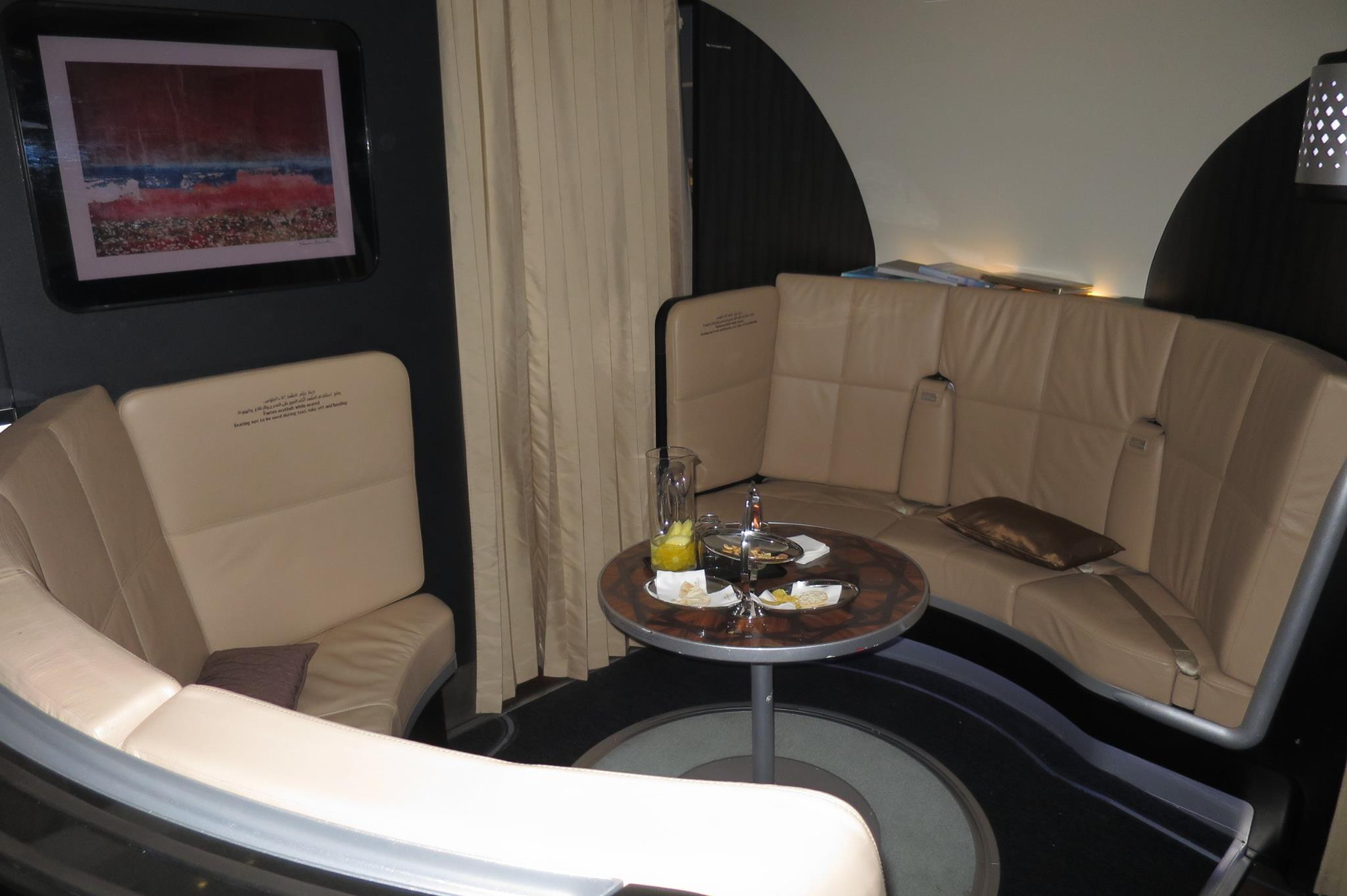 Between first class and business class is a nice little lounge area