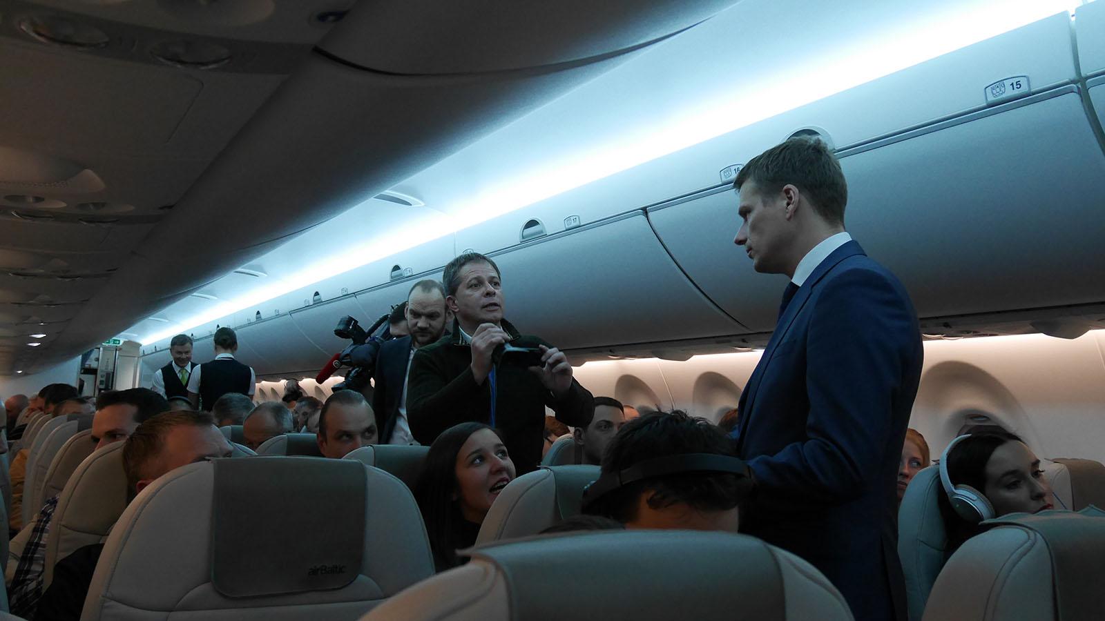 Full flight, crew, plus media
