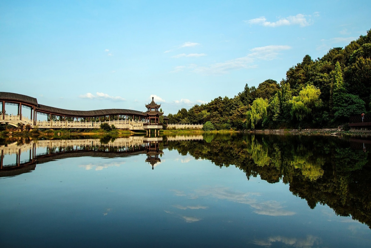 Day 6: Changsha- Mount Yuelu - Stretch your legs with a scenic walk in this Mountain Park. Peek down at Changsha through the trees at the summit or take in the view on the chair lift back down. Just make sure you work up an appetite!