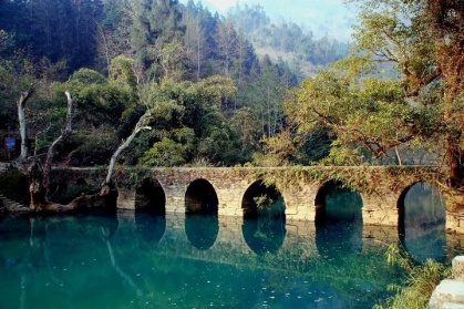 Day 3: Libo County - Travel to Libo County to soak in the stunning Xiaoqikong Scenic Area. Visit the famous and utterly charming seven arched Xiaoqikong Bridge, built in 1835, surrounded by luscious forest and pearly blue water.