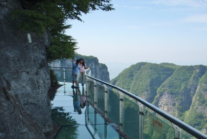 Day 9: Zhangjiajie- Tianmen Mountain - Reach the top on the world's longest cable car, then follow the glass walkway as it impossibly hugs the side of the mountain, looking down if you dare. Finally ascend the 999 steps to reach Heaven's gate.