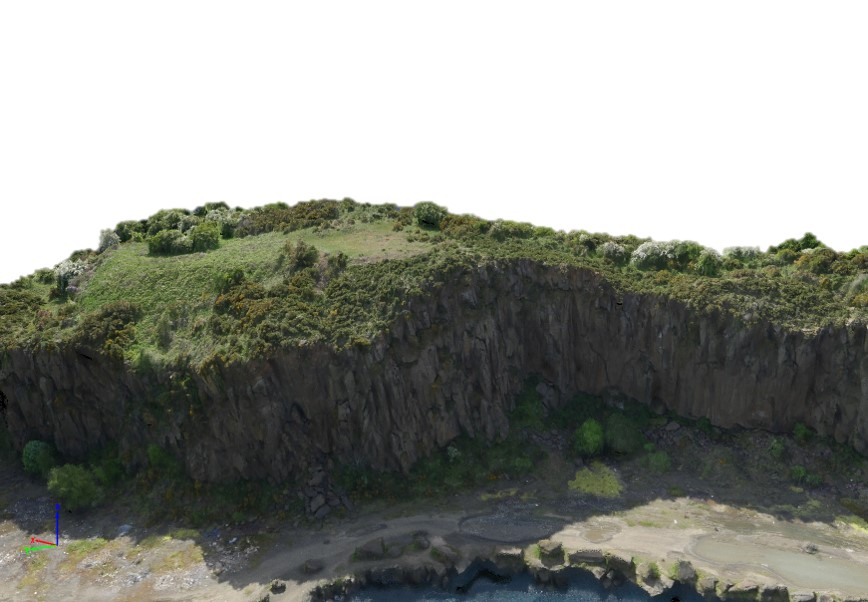 This may look like an image of a cliff but it's actually a screen grab of a 3D point cloud model produced using photogrammetry. We surveyed and modeled this old quarry using Photogrametry. About 100 images were taken using a DJI S1000+ with a Panasonic GH4 at an altitude of 100 meters.   Click to find out more about our aerial drone survey services