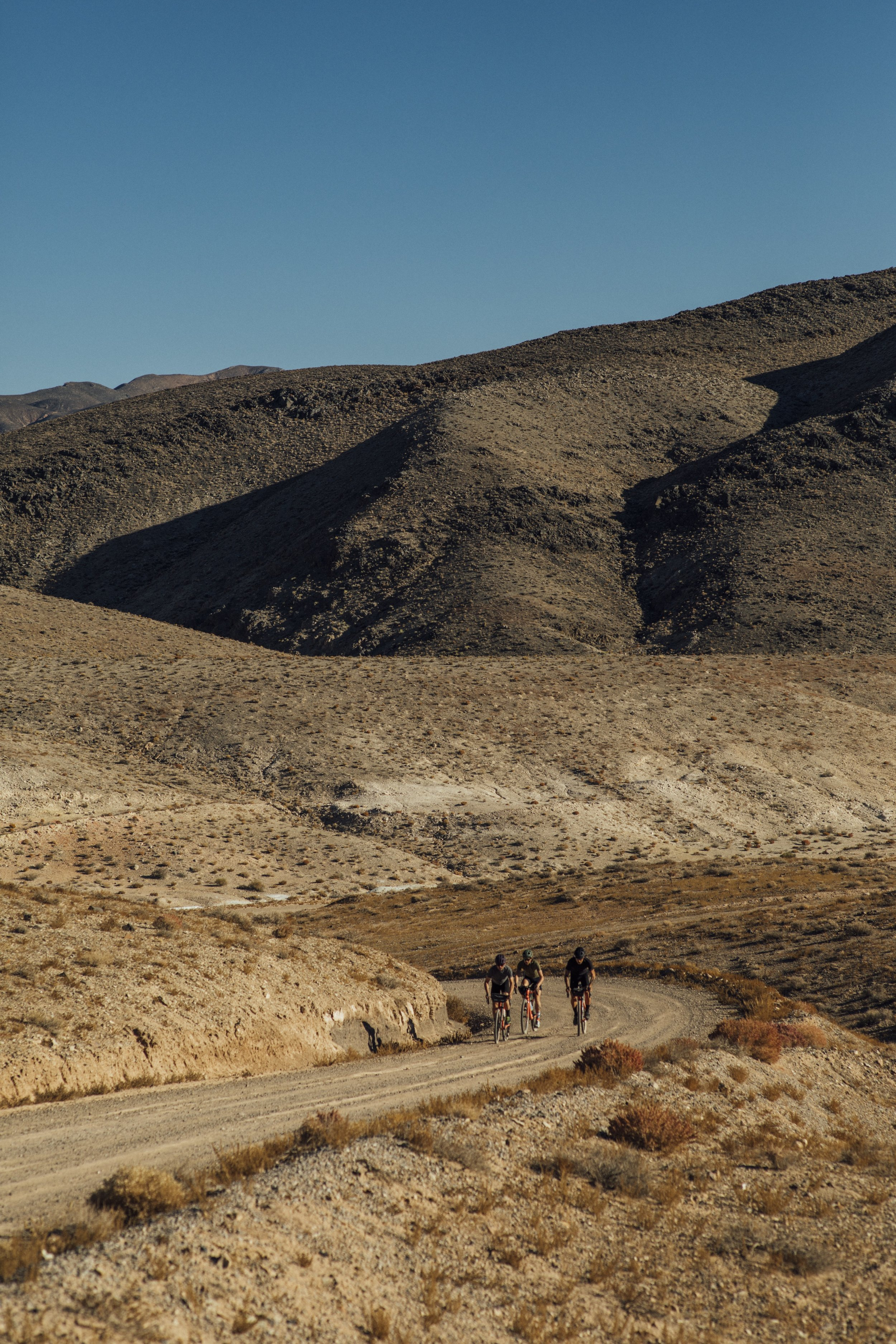 They ride through a valley of death, out and over a long, dusty road. -
