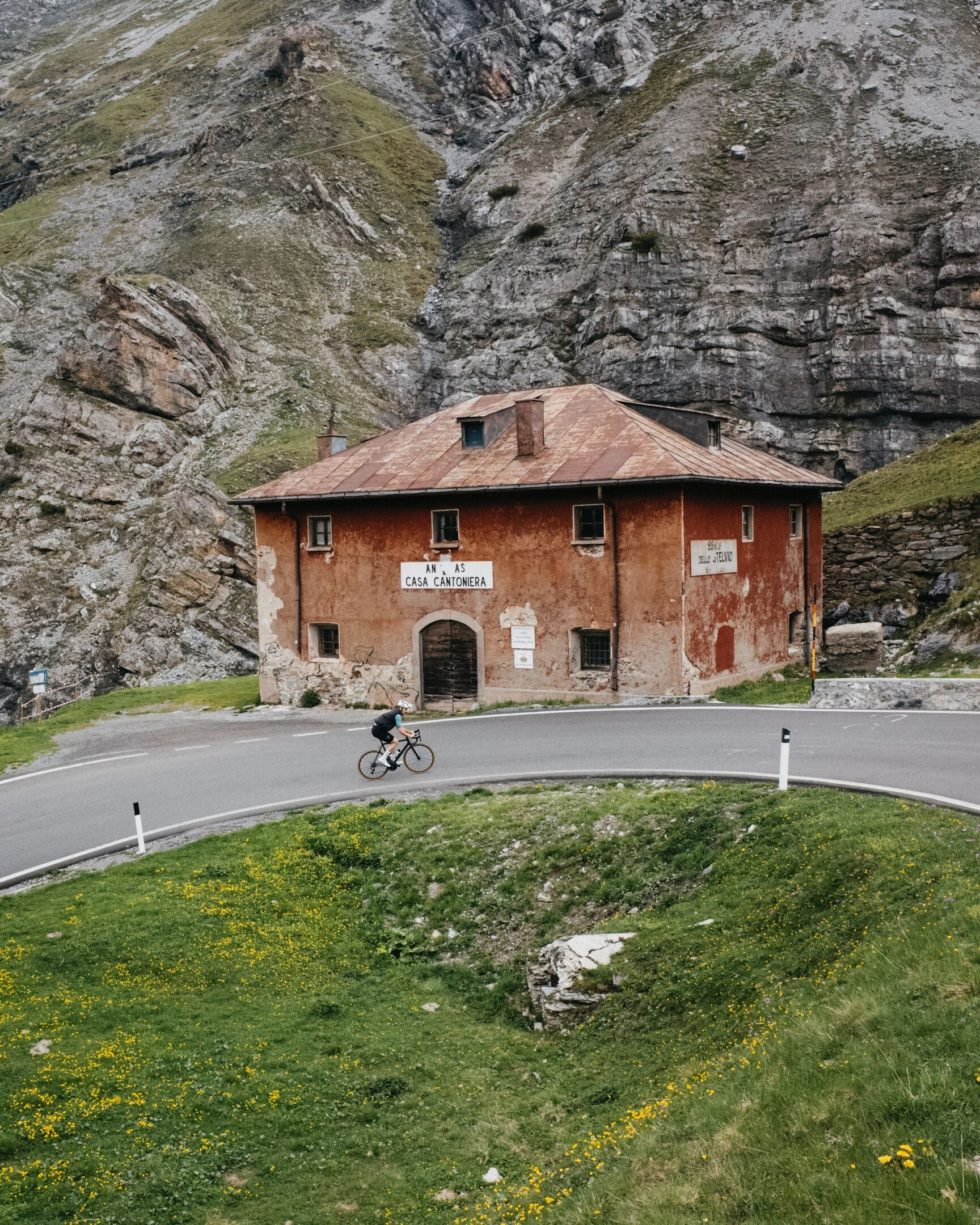 """- """"After crashing out and getting picked up by the guys, accompanying the group up the Stelvio as a Soigneur offered a completely new view on the sport that I love. I felt like part of a team more than ever."""" - Sebastian Bentzin"""